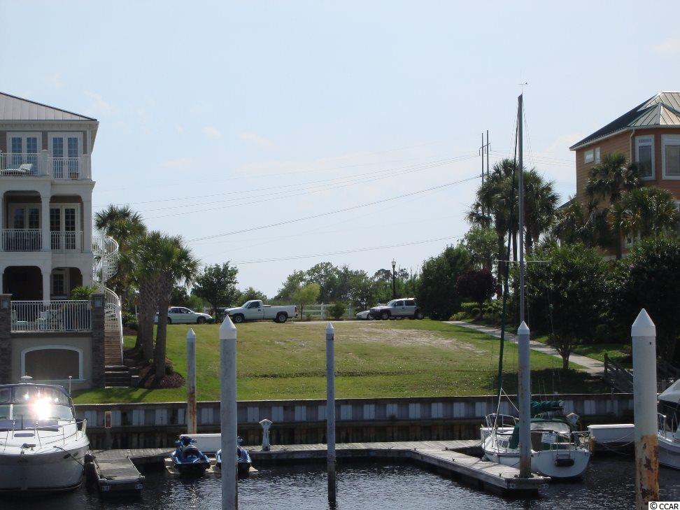 Wonderful Waterfront lot in the  exclusive Marina Bay Community in North Myrtle Beach. Park your Yacht in your back yard (Boat slip available to purchase). Only a short boat ride to Bird Island and the Ocean and a short golf cart drive to the beach, shopping centers and restaurants!  This high, dry and level lot which is 68 ft. wide and 150 ft. deep is ready for you to build your dream estate!  Don't miss out not many available like this!  You will love the beautiful views of marina and intracoastal waterway from the back of your new home!