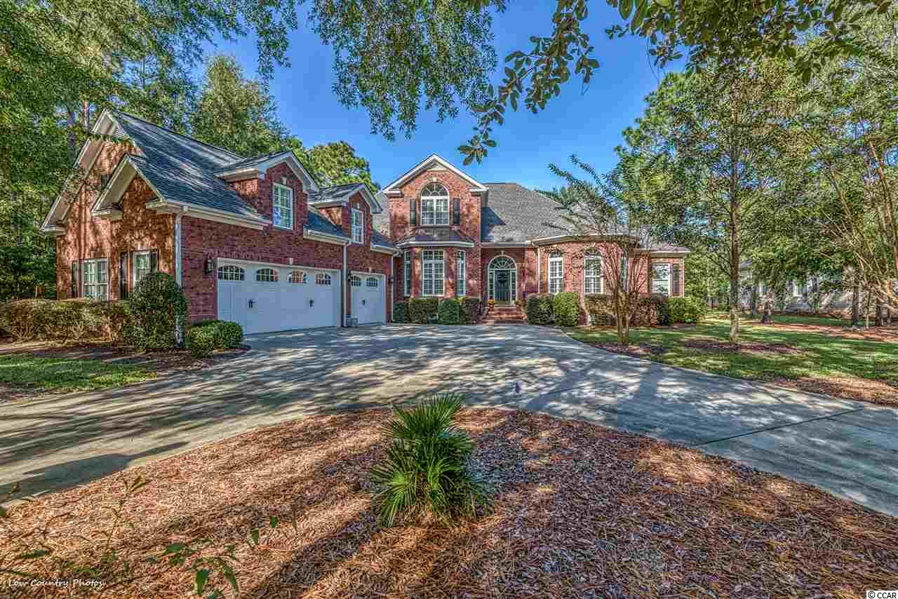 Located on the private Greg Norman course of The Reserve in Pawleys Island is 397 Preservation Circle.  The Reserve is an exclusive guard-gated community. Not only does this first-class community offer a private golf club, but it also features a marina and beach access via Litchfield by the Sea.  Come live life as it should be at 397 Preservation Circle.   This custom-built estate home sits on seven-tenths of an acre.   Once through the front door, you are drawn into the house by the impressive sightlines, custom woodwork, and built-in cabinetry.  A gourmet kitchen featuring a Thermadore gas range/stove, Sub-Zero refrigerator, Viking beverage center, wet bar, and the massive island will be a fan favorite for all that see it.  After a day or night of entertaining, everyone may retreat to their bedrooms.  The first-floor oversized master suite has his and her walk-in closets and an en-suite bathroom with a large shower, double sinks, and tub.  Rounding out the main level are two additional bedrooms and a spacious office.   Upstairs you will find plenty of private living space.  Two generous bedrooms and a multifunction bonus room provide ample room for sleeping arrangements.  Additionally, the upstairs features a separate living room.  This upstairs den will make a perfect movie night or weekend sports center with a Viking beverage center, wet bar, and surround sound.  A charming Southern back porch and large brick paver patio will provide countless hours of serenity.  Overlooking the #4 of the Norman course, this setting offers a perfect backdrop for a tranquil evening.  Tons of storage, plantation shutters, outdoor storage room, oversized three-bay garage, are just a few of the appointments of this magnificent home.   The rest of your life is waiting for you at 397 Preservation Circle, Pawleys Island SC 29585.