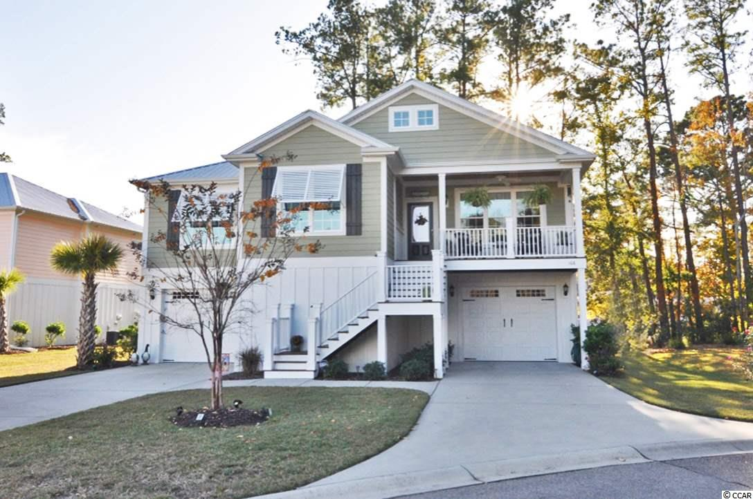You'll immediately fall in love with this beach bungalow home!  Located less than a mile from the beach, this golf cart friendly neighborhood has a community pool, natural gas, and low HOA fees!!! Have you always wanted to move to the beach, but high prices keeping you away??? Reflection Pointe gives you the best of both worlds of having the neighborhood feel, while enjoying the coastal living lifestyle at its finest!!! With plenty of garage space, plenty of outdoor living, as well as an open floor plan, this home checks all the boxes for buyers in any stage of life. All bedrooms and bathrooms are located on the main level, but you could easily enclose living space on ground level if more space is needed. The large master bedroom has a massive master closet along with a large tile walk-in shower, dual sinks and linen closet. Features include: tankless water heater, natural gas heat, security system, Bahama shutters, granite counter tops, stainless steel appliances, plus much more!  Washer & Dryer convey along with all blinds and all curtain rods. Make sure to put this home on your list to come see! At this price and in this condition, it certainly won't last long!!!