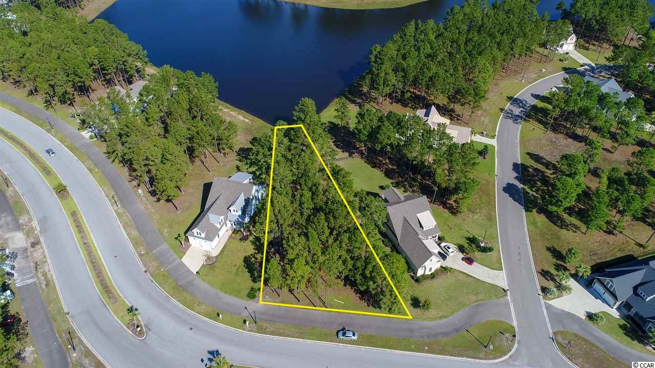 What an amazing LOT to build your dream home on! Lake Lot on Palmetto lake in this gated community of Waterbridge; consisting of 80 acres of lakes!!!This is Resort Living at its finest.This is one of the largest waterfront lake lots in Waterbridge.  The elaborate amenity package in Waterbridge features the largest swimming pool in South Carolina,tennis courts, basketball courts, 24 hour fitness center, Village Style Clubhouse, Palmetto Lake & Boat Launch. Close to all Beaches, entertainment, Schools, Theater,Grand Strand Hospital, Broadway at the Beach, Coastal Grand Mall and Coastal Carolina University. This is a Prime Location. Lake Front Lots are becoming hard to find. Get in time to build for the Spring Season.