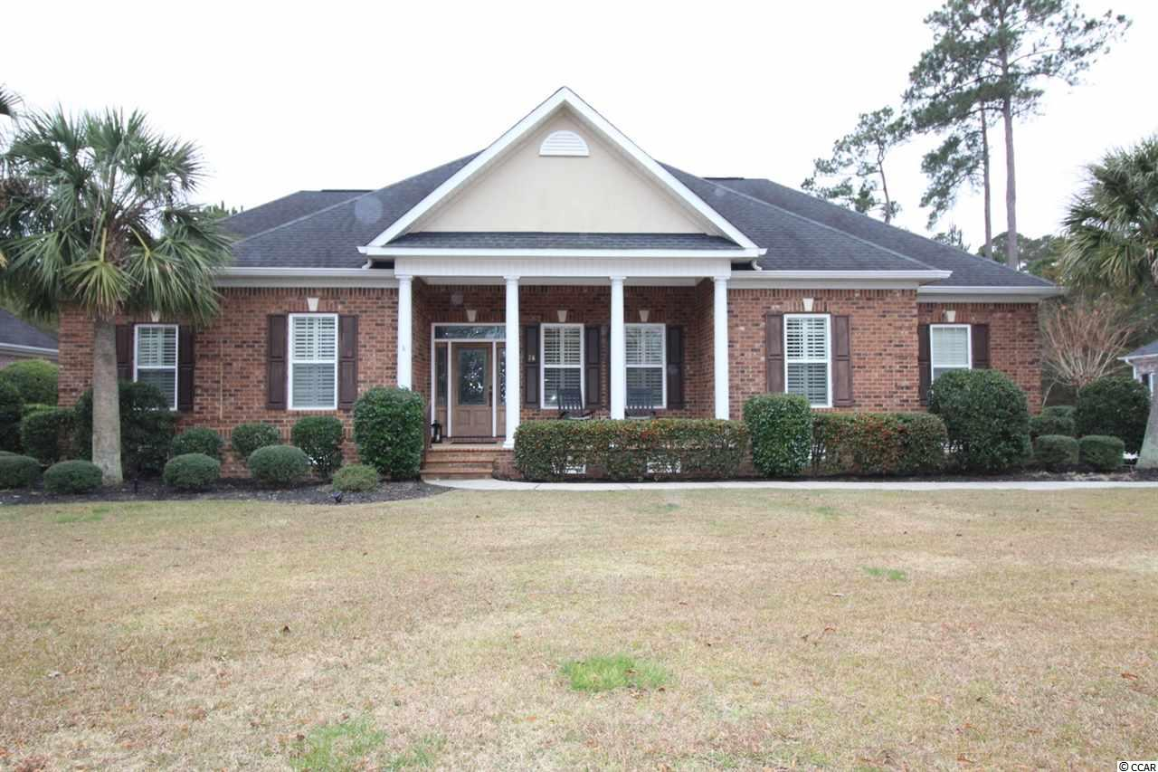This quality all-brick 4 BR, 3.5 BA custom home is located in the gated golf course community of Highwood in Prince Creek. This well-maintained home is move-in ready with numerous high-end custom upgrades and extras. The open floor plan is a split bedroom design featuring plantation shutters, detailed crown moldings, wood & tile floors and much more. The center of the home is the spacious great room with a gas fireplace, ceiling fan, built in shelving and entry foyer. The kitchen features custom cabinetry, stainless steel appliances, granite countertops, ceiling fan, recessed lighting & pantry. The luxury master bedroom suite provides 'his&her' walk-in closets, double sinks, quartz countertops, tiled shower, whirlpool tub and linen closet. The sunny Carolina room exits onto the back porch which has E-Z breeze windows, allowing for year-round enjoyment. The formal dining room is off the kitchen next to the entry foyer. There is a full-size laundry room with granite counter tops and cabinetry which matches the kitchen. The large bonus room over the garage provides a separate living space with mini-refrigerator, sink and full bathroom – an ideal location for a home office and/or 4th bedroom. The oversized side load garage has an air-conditioned workshop with half bath. The home is located on a 0.41-acre lot with irrigation system and a spacious back yard overlooking a small pond and plenty of trees which provide privacy. Residents of the Highwood Community enjoy use of the pool, clubhouse, fitness room, tennis courts and walking paths. Located in in Prince Creek, this home is conveniently close to retail, groceries, pharmacies, the Murrells Inlet Marsh Walk, Huntington Beach State Park, Tidelands Community Hospital and all the amenities that the South Strand has to offer.