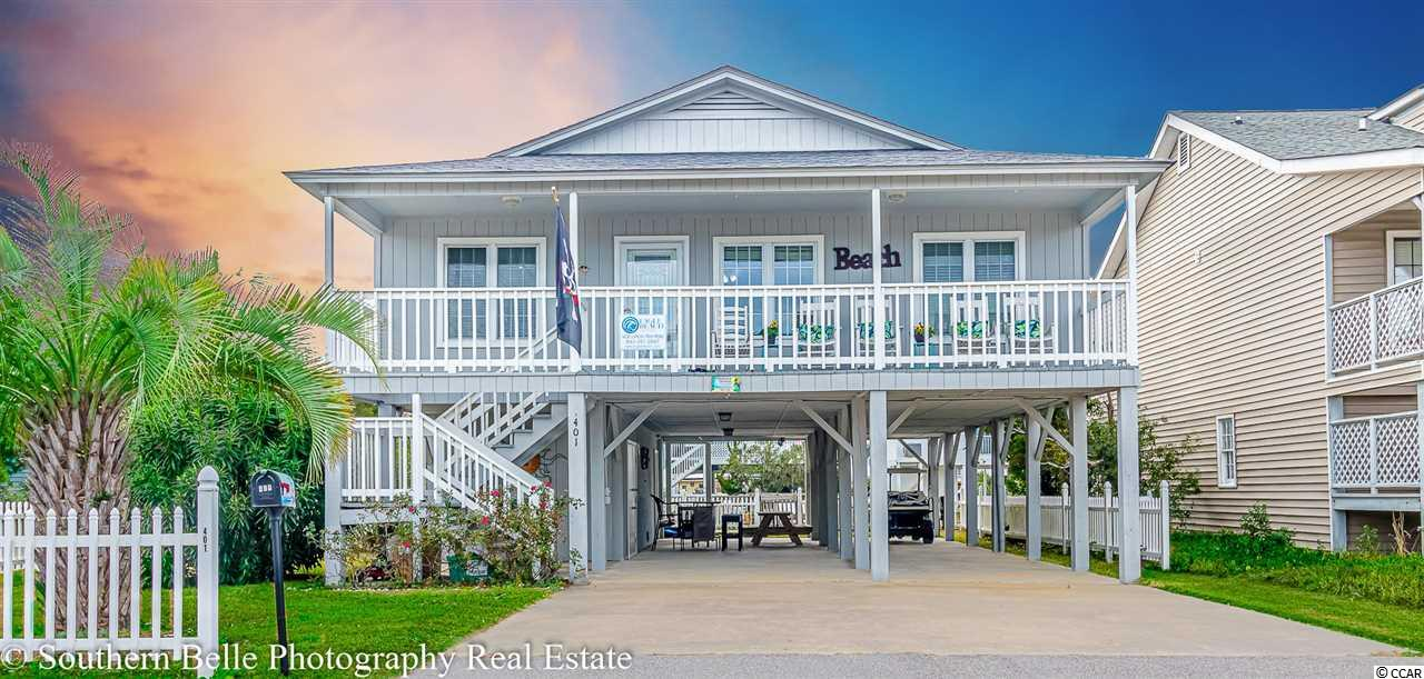 This beautifully remodeled Cherry Grove 4 bedroom, 3 bath Channel home with a dock, has stunning views of the channel in the back and Marsh in the front. No extra channel fees. Only 4 blocks to the ocean!  Includes an outside shower with hot and cold water. Brand new heating and air system installed 11/30.