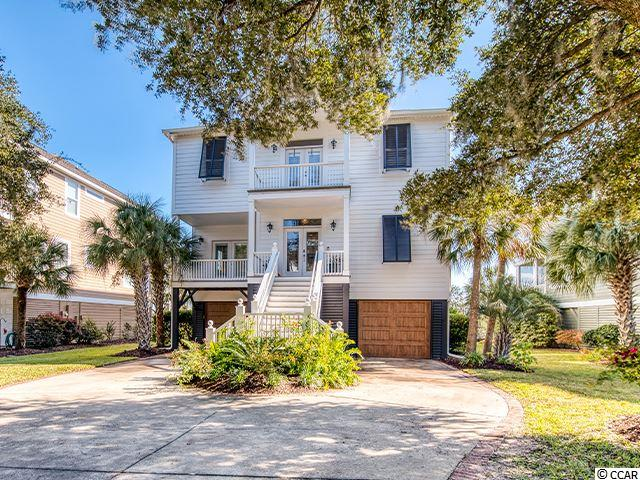 """Stunning Marsh Front residence with permanent Ocean views. Extensive renovation completed in 2018 at the direction of an acclaimed local designer. Renovation includes all new: custom tile work, vanities, countertops, sinks, light fixtures, plumbing fixtures, custom-stained nail down oak flooring throughout, fireplace with built-ins, fully updated kitchen with large island featuring 36"""" gas range with pop-up downdraft, and two 2019 Lennox HVAC units. Exterior renovation includes fully fenced in yard, irrigation system, landscape plan, fully functional Bahama shutters, automatic roll down hurricane shutters, full exterior repaint, screen conversion for second level porch, garage doors, pool pump w/ saltwater conversion, removable child-safety pool fence, and the addition of many smart home features including thermostats and key-pad deadbolts. No expense has been spared. Breathtaking, panoramic view of the salt marsh and Midway Inlet from all levels. Picture yourself enjoying a cocktail while gazing out onto the salt marsh from within your salt water pool! A must-see home unlike any home in the area."""