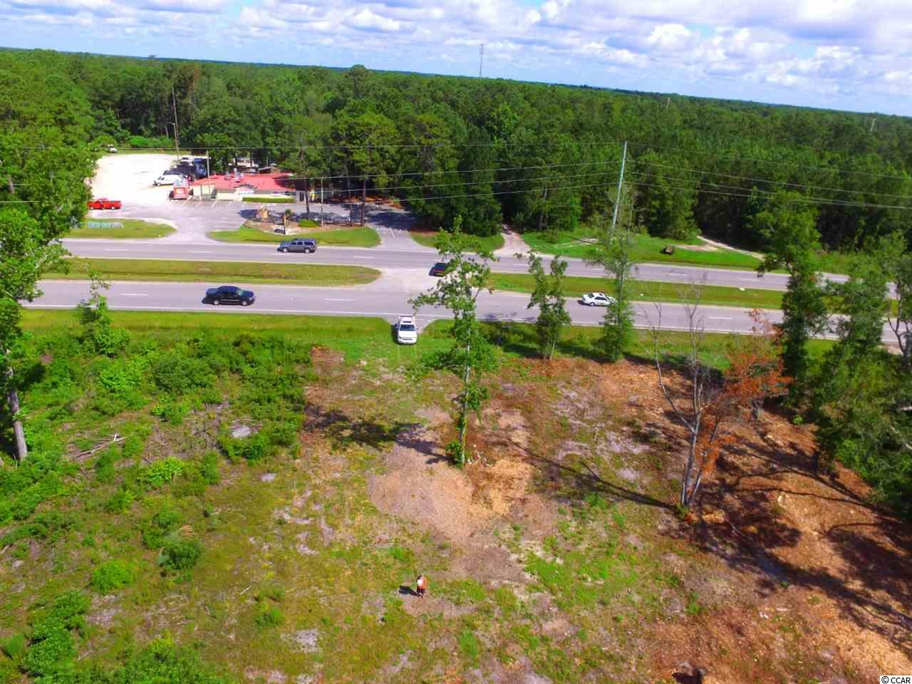 Commercial lot in Pawleys Island on Ocean Hwy (Rt 17). This lot has major road frontage on Ocean Hwy (Rt 17) and with a daily traffic count over 5,000 vehicles per day. This lot has been bushed hogged and semi cleared. This commercial lot is great for any business that requires big exposure. Do not miss out on this commercial opportunity.