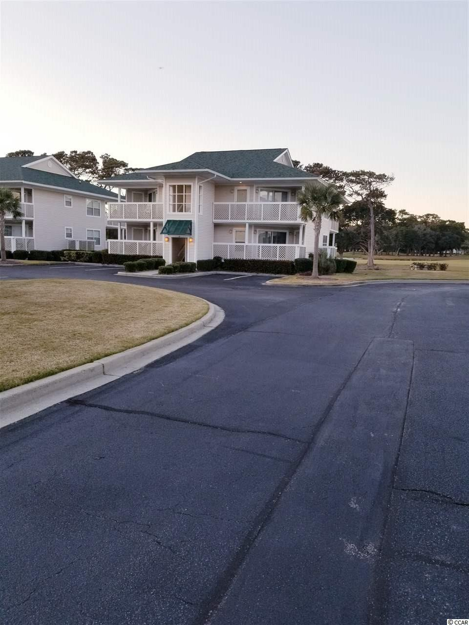Spacious and open 2br/2ba with amazing views of lake and Surf Club golf course.  Located across the street from public beach access. Recently painted with newer refrigerator and dishwasher. Furniture less than 2yrs old. Well taken care of, never rented. This unit features all laminate and tile floors, front and back porches for relaxing, tiled walk-in double shower and large detached storage for beach gear. Community offers outdoor pool and hot tub. Call and schedule your appointment to see today before it's gone!