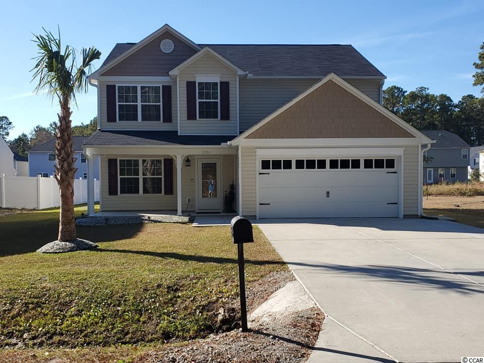 If you are looking for a spacious home and desire to be less than 5 minute drive to Cherry Grove Beach, this is your home. Home is conveniently located within one block distance to North Myrtle Beach Middle and Elementary Schools. Home was built in 2018 and has approximately 2400 heated square feet. This floor plan includes two master bedroom suites with master baths that are located on first and second floor. This home has a very nice kitchen that includes stainless steel appliances and upgraded counter tops. The second floor includes a family room with wooden plank accent wall, two additional bedrooms, and another full spacious bathroom.  Washer & Dryer and Hot Tub convey with the sale of the home. There are multiple storage detached storage sheds in the backyard. The concrete driveway was extended to accommodate larger vehicles. Do not miss out on your opportunity to own this very nice well maintained spacious home located minutes from the ocean.