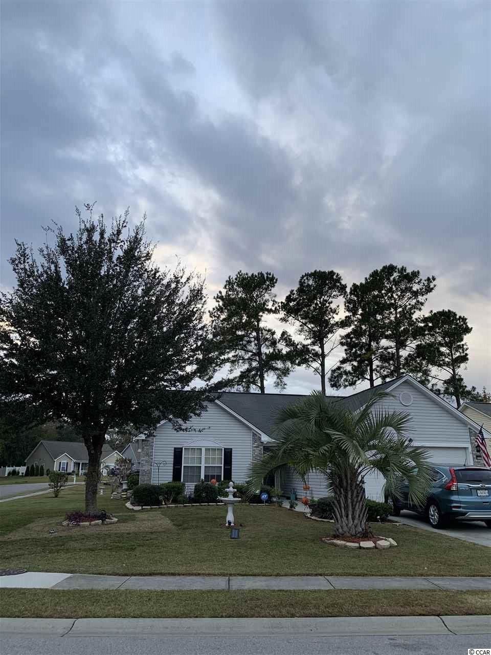 Three Bedroom, Two Bath home in Hidden Lakes village has an open floor plan with a beautiful screen porch on the back overlooking a lake.  Close to the ocean, restaurants and low HOA fees.   There is a community pool, park, tennis court and clubhouse.