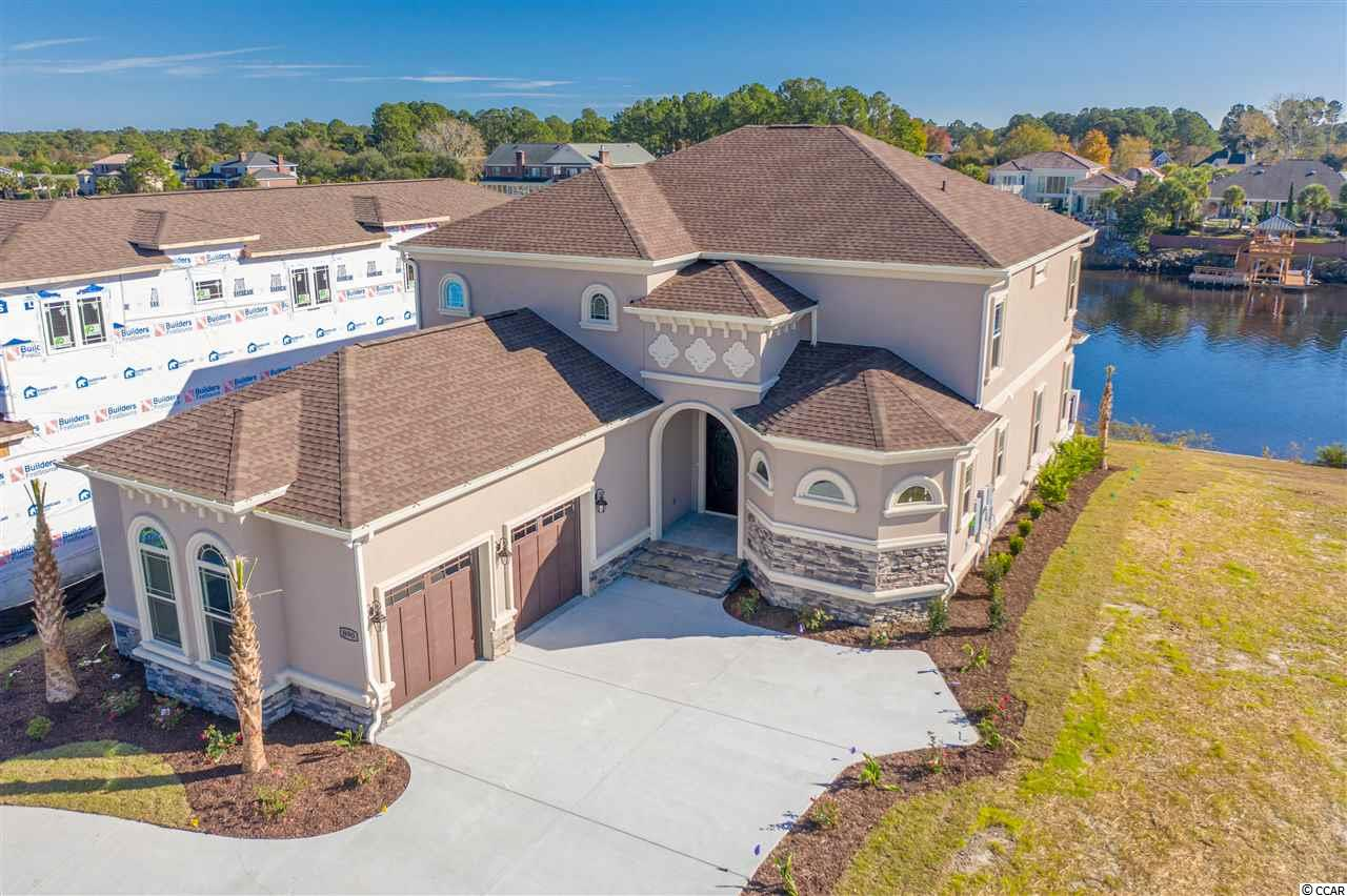 ICW Masterpiece! Brand new construction located directly on the Intracoastal Waterway. Be the first to call this dream home yours. Some of the many features include stunning views of the waterway, first floor master bedroom with private bathroom suite, his and hers walk-in closets, lighted tray ceiling, stacked stone fireplace in the living room, coffered ceiling, custom designed kitchen with Kenmore Elite appliance package, walk in pantry, gas cook top with wall oven/microwave combo, large single bowl sink. An additional bedroom and full bathroom are located on the first floor. Upstairs you will find a large loft/den/family room with views of the waterway. Three large bedrooms and two full baths. There is also an unfinished storage room. Waterproof EVP Flooring throughout the entire home. Over sized side load garage with additional storage above. Out back you will find a weather resistant deck spanning the entire length of the house to take in the views. Community offers gated entry, swimming pool, tennis courts, boat ramp, boat storage and clubhouse. Located in the most desirable school district and only minutes from the beach, shopping, restaurants and all that Myrtle Beach has to offer.