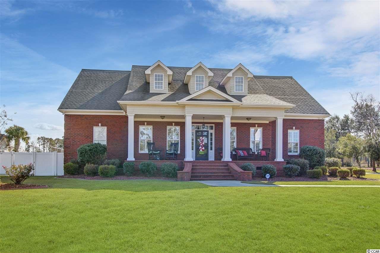 """Come home to this custom built all brick beauty and enjoy elegant upgrades and spaciousness throughout. This home has 5 bedrooms, 3 full baths, and 2 half baths plus a bonus room. The heart of a home is always the kitchen, and this one is sure to be a favorite for you. A work island, breakfast bar, and lots of windows make this a great place to cook and to enjoy family and friends. The great room has a gas fireplace and overlooks the back porch. The master bedroom and bedrooms 2 and 3 are downstairs while bedrooms 4 and 5 are upstairs along with a bonus room. There is room for a craft room, workout room, or any kind of space you may need. The list of upgrades include plantation shutters throughout, stainless appliances, vinyl double hung windows, crown molding, irrigation and more. Outside, you have plenty of space in the 3 bay garage and extended driveway. There is no HOA so you can park your boat or RV. The home has an amazing outdoor space that features a back porch and a 12,000 gallon saltwater pool. Located just 10 minutes to downtown Conway and 30 minutes to Restaurant Row in Myrtle Beach via Hwy 22.  This home had a pre-listing home inspection and is a """"Smooth Move"""" listing."""