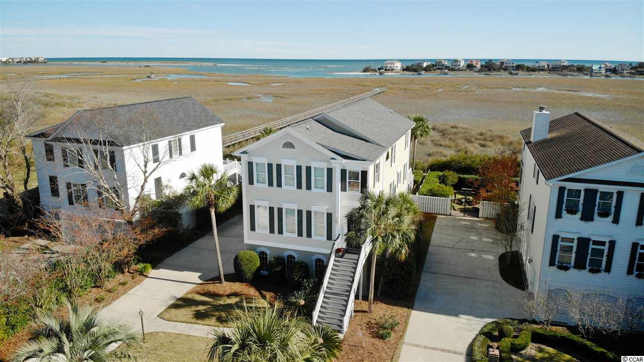 Unbelievable ocean and creek views abound from this nearly 4000 square foot Charleston style home.  Start living your best life now, located in the heart of Pawleys Island in the private, gated community of Oak Lea.  Take in the amazing scenery from the spacious main living and kitchen area, perfect for entertaining family and freinds. Beautiful heart pine floors provide charm and character throughout the main living area. The top floor, spacious master suite has the most spectacular views in the house and a large private screened porch to sit and enjoy the ocean breeze.  Two additional bedrooms, a bathroom, an office and convenient laundry room complete the top floor. The bottom floor has a recreation/second living room and half bathroom perfect for entertaining or as a media/theater room.  Roof replaced in 2017. This home has been recently renovated and updated with top of the line appliances. Other recent updates include new interior doors, front door, new windows, hurricane shutters, completely updated bathrooms, gas fireplace and kitchen updates.  The community dock which was replaced in 2016, leads you to the endless beauty of the Pawleys Island creek for enjoying sunsets, kayaking and crabbing.  Oak Lea residents enjoy a community pool and tennis court.  Let us show you 217 Berry Tree Lane today!  Pawleys Island is located just a 70 mile drive to spend the day in historic Charleston, SC or a 25 mile drive to the attractions of Myrtle Beach.  Minutes to beaches, shopping and fine dining!