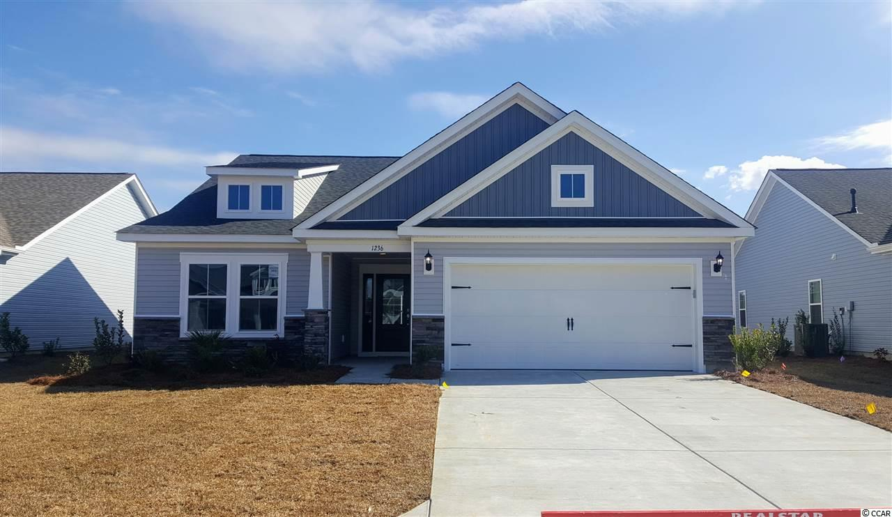 This Maple floor plan features SS appliances with a Natural Gas Range, Granite Countertops, EVP and Tile Flooring. Attic Storage over the 2 car garage, extended patio for grilling and irrigation system.