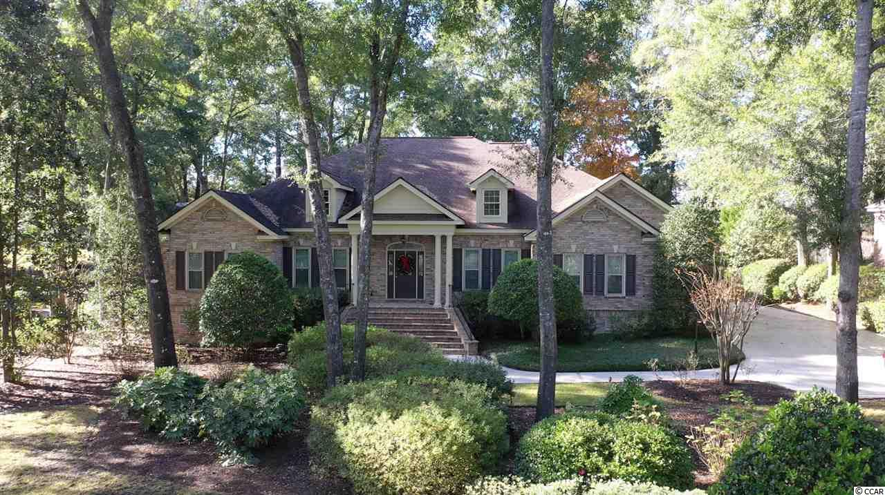 This beautifully maintained 3600+ square foot all brick home is nestled on over half an acre overlooking the 15th fairway of the exclusive Wachesaw Golf Club in the private residential golf community of Wachesaw Plantation! The spacious main level encompasses 4 bedrooms and 3.5 bathrooms. Upstairs you will find a bonus room with a second half bath! The spacious Master bedroom suite offers dramatic tray ceilings and a large, beautifully tiled Master bathroom with jacuzzi tub and separate walk-in shower. The formal dining room is perfect for entertaining friends and family. This incredible home offers both a family room and a distinguished formal living room. Gourmet kitchen offers beautiful tile flooring, hard surface countertops, elegant under cabinet accent lighting and with a breakfast bar and delightful breakfast nook. Big, covered screened porch offers the perfect peaceful retreat, surrounded by the tranquil beauty of mature landscaping and offering stunning views of the 15th fairway. You will also love spending afternoons on your large patio with lovely low brick wall border. Wachesaw Plantation is designated as a South Carolina Wildlife Refuge and is an archaeological research project of the University of South Carolina. The Wachesaw Plantation Club offers a Golf Course, Tennis, Swimming Pool & Restaurant for Members. The Murrells Inlet Marshwalk with Restaurants and Entertainment is less than 5 minutes away! World renowned Brookgreen Gardens, Atalaya Castle and Huntington Beach State Park are only minutes away!