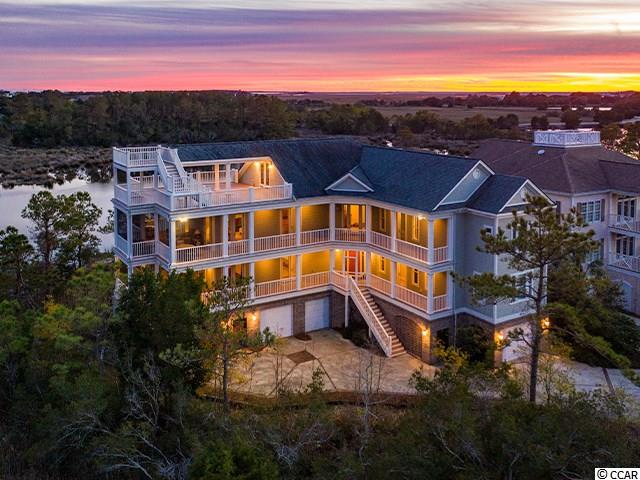 DeBordieu Colony - Dazzling marsh views from this 6 Bedroom, furnished coastal retreat with an elevator can now be yours…. just in time for Christmas! 190 Permit Court offers expansive decks and porches and is in a prime location within walking distance to the private access on the north side of DeBordieu Beach for Ocean Oaks owners and their guests. (Though it has never been rented, the experts tell me it would ton it on the rental market.) Watch the sun rise over the ocean and set over the creeks and marshes of North Inlet.  Enjoy the abundant natural light in the living room with glass doors and tall windows on 3 sides, a fireplace, and gorgeous views! The light and airy kitchen is open to the living room and features beautiful cabinets, stainless steel appliances, double ovens, a 6 burner Wolf cook top, an island breakfast bar with a sink and a beautifully framed marsh view window over the sink for the Chef! The formal dining room offers that same fabulous marsh view and can be accessed from the foyer, or from the kitchen through the convenient butler's pantry. The spacious master suite, also on the main living level, is accessed through a private hallway with built-in shelves. With a beautiful sunrise view, the master features a double sink vanity, large shower, his and hers walk-in closets, and a private water closet. Take the stairs or elevator to the top floor to enjoy this versatile space with a full bath and access to another large deck, and an additional viewing deck, from where you will delight in views of the ocean! The guest suites are on the lower level, some with access to decks and porches. On the ground floor is a spacious garage area for cars, boats, and golf carts, the preferred mode of transportation here at DeBordieu Colony. Other features of 190 Permit Court include: Brazilian cherry floors, crown molding, hardiplank exterior, tiled showers, Powder Room, Laundry Room and a low maintenance yard with bulkhead.    DeBordieu Colony is located abou