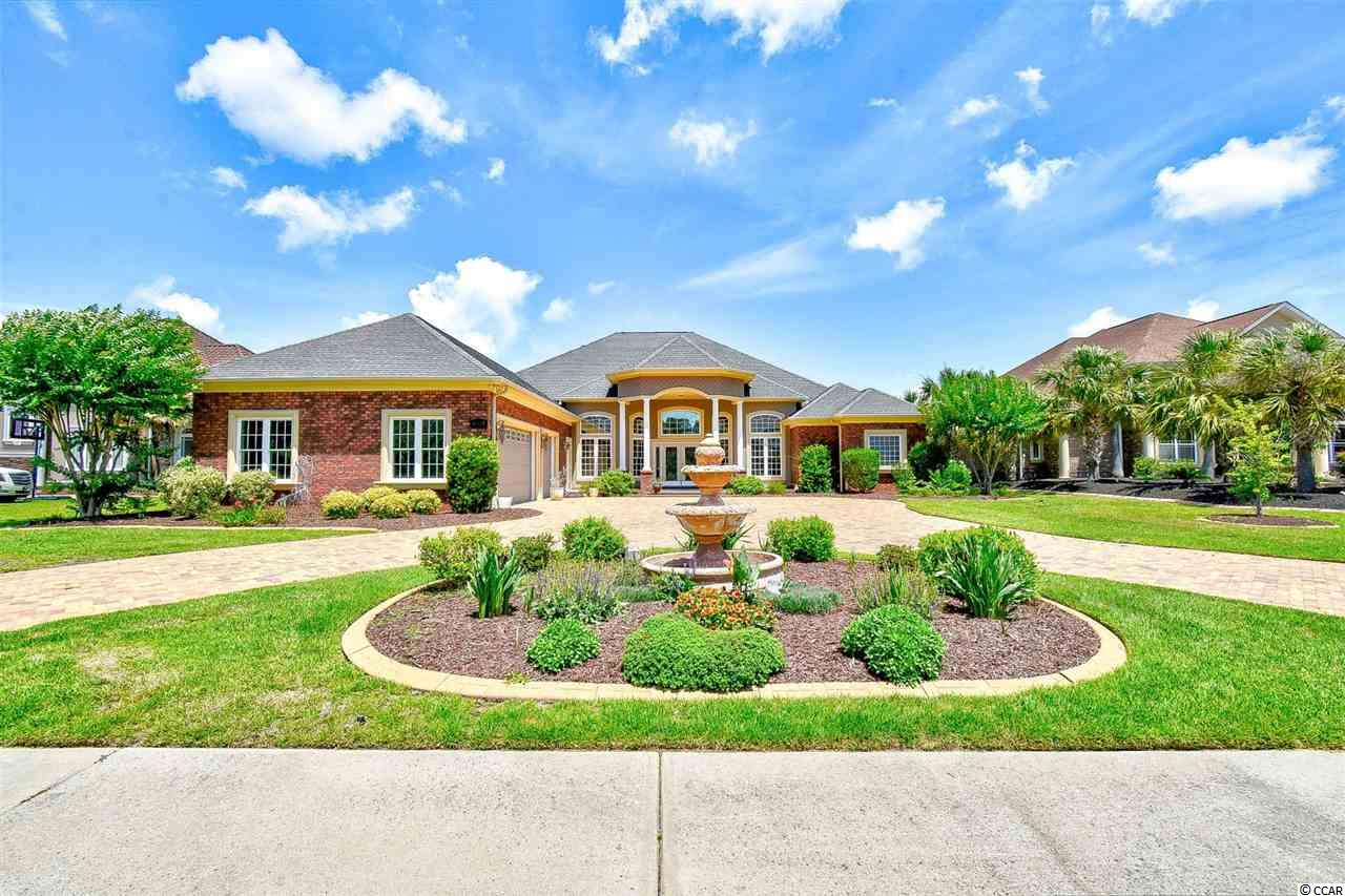 """Welcome home to this beautiful 4 bedroom, 2.5 bathroom home with 5200 heated sq. ft in the prestigious community of Plantation Lakes. This home features all the upgrades and sits on a premium water lot with 100' of lake frontage. As you enter, you will immediately notice the luxurious tile and wood flooring throughout the main living areas, 18ft multi-layered back lit tray ceilings, built in surround sound and sound proof walls, a formal dining room, and a kitchen fit for a chef. The kitchen is equipped with all stainless steel appliances including a gas range, double ovens, custom 42"""" cherry cabinets, a large work island with breakfast bar, breakfast nook-separate from the formal dining room, and a spacious pantry. Each bedroom includes a ceiling fan, plenty of closet space, and easy access to a bathroom while the master features the luxurious tray ceilings with recessed lighting, a tiled walk in shower, double sink vanities, an oversized whirlpool tub, and spacious walk in closet. Enjoy afternoons on your back patio, relaxing in the jacuzzi, and enjoying the beautiful views of the lake. A bonus room and an extra den can be used as a home office, play room, rec room, etc. The options are endless with this home. Make this your forever home; Schedule your showing today!"""