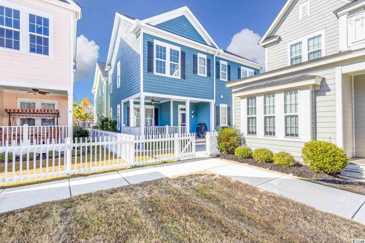 """Welcome home to your Charleston Style home in Sweetgrass. This is low maintenance living in the community of The Market Common in Myrtle Beach. This is a """"York"""" floorplan with 3 bedrooms, 2 and a half baths. This home features pristine hardwood throughout the main living areas, crown molding, a gas fireplace and custom paint throughout. The kitchen has a generous amount of 42"""" cabinets, granite countertops, a breakfast bar, gas range, and walk-in pantry. The owners' suite is on the first floor! This suite features a double vanity, walk-in tile shower with dual showerheads, and walk-in closet.  The 2 bedrooms upstairs and oversized bonus room upstairs has plush, fresh carpet and this bonus room could serve as a media room, playroom, or extra living room. The backload 2-car garage is spacious and surrounded by extremely low maintenance landscaping.   Living in this community there is easy access to the beach, dining, shopping, and entertaining... all is a golf cart ride, bike, or walk away! Trails, bowling, a dog park, a movie theater, playgrounds, and gyms are all just some parts of living the lifestyle of The Market Common. Schedule your showing of this immaculate gem today!"""