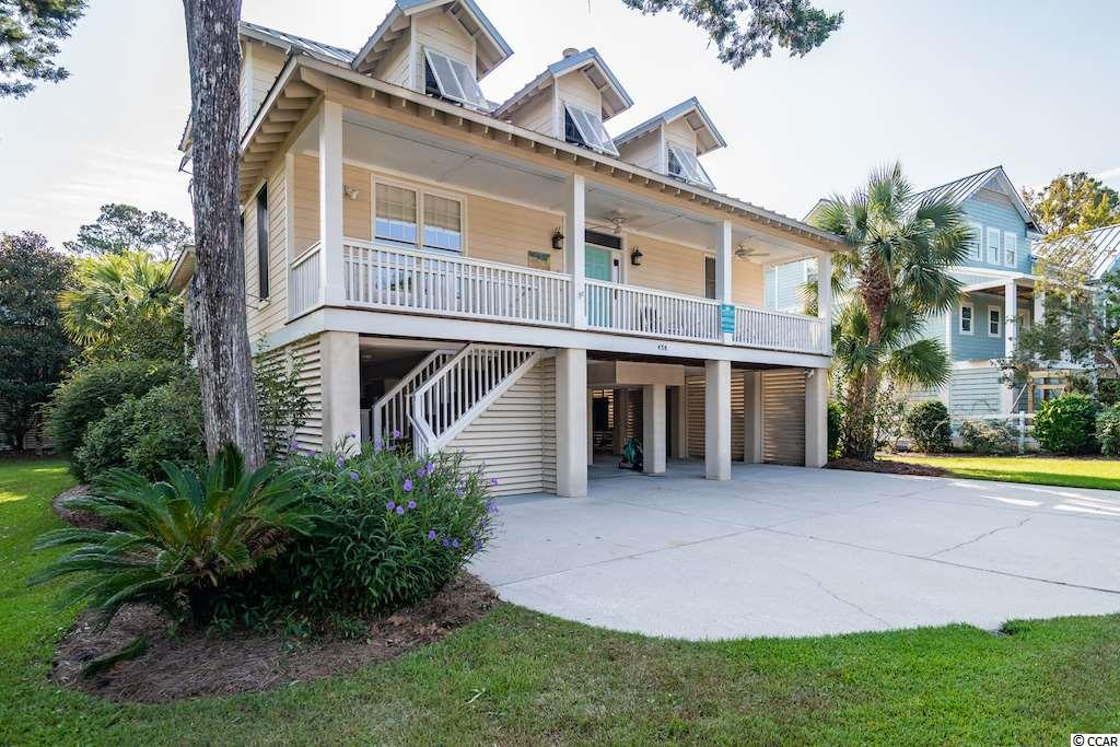 "Welcome to C'est La Vie! One of North Litchfield's most popular beach rentals is now yours for the taking!  A traditional family style beach house that is warm and welcoming the second you enter the front door! In immaculate condition, you will feel right at home in this airy, open floor plan featuring hardwood floors throughout, front covered porch and large back screened porches. Plenty of room to breathe inside and out.  New appliances in kitchen and new hardwoods upstairs. Near bike paths to Huntington Beach or just a quick stroll or golf cart ride to the North Litchfield beaches.  Or head on over to the large community swimming pool. Furnished and ready to go this house is so comfortable that you will definitely find it is aptly named:  ""This is the Life!"""