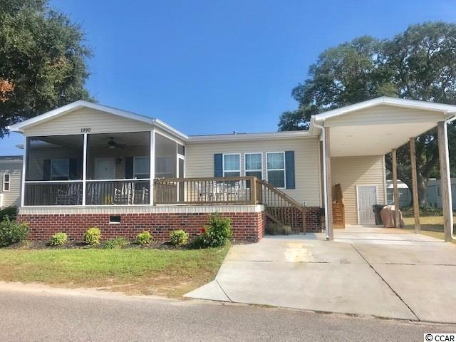 This beautiful fully furnished home features 3 bedrooms, 2 full baths.  It is located in the gated community of Oceanside Village, and is located right across from Oceanside Village's largest lake with a perfect view of the fountain from the open deck and screened porch.  This home features an open floor plan unlike any other in the community!  The kitchen features a HUGE breakfast bar, stainless steel appliances and dining area. There is beautiful laminate flooring throughout the living room, kitchen and dining area.  The master bedroom has a tray ceiling, large walk in closet, and attached bath with double vanity, garden tub/shower combo and linen closet.  The home also has 2 additional ample size bedrooms with large closets.  The master bath and the guest bath, along with the laundry room have ceramic tile flooring.  Exterior features of this home include vinyl siding, brick underpinning, carport, storage/golfcart shed, open deck, screened porch, concrete drive, and irrigation.  Enjoy evenings on the screen porch taken in the beauty of the fountain, and listening to the sounds of the ocean.  This home has excellent rental history and snowbirds booked for 2020 as it has been a fan favorite for renters!  Did we mention Private Beach Parking?  Bank Financing Available. Conveys Fully Furnished !  This home will not last long! What are you waiting for???