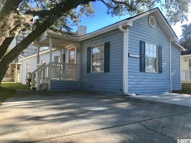 Your Seaside Escape!  Make memories here in this updated 3 bedroom, 1.5 bath home located just the 2nd street back from the ocean!  Covered front and rear porches, large living room addition, outdoor shower, NEW laminate flooring throughout home (2018), NEW roof (2018), NEWER Pex plumbing (2018), NEWER main bathroom(2018), NEWER HVAC with overhead ducting (2017), 3rd bedroom addition (2017), NEWER half bathroom (2017), NEWER vinyl siding (2016), NEWER storage shed (2016)  Nicely decorated and sold mostly furnished!