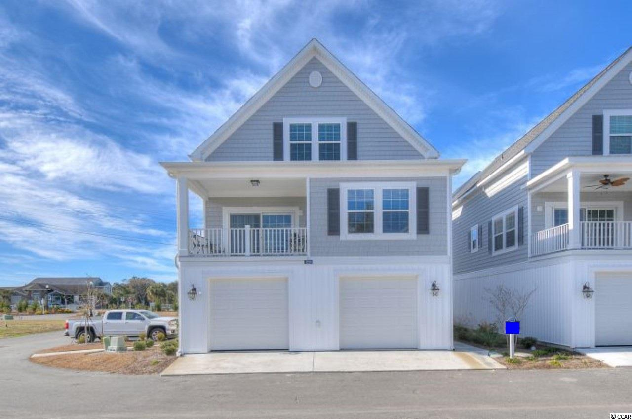 Former Model home with ELEVATOR...NEWER Construction with awesome views of the Intracoastal Waterway from this raised home at Cape Cod Cottages at Marker 350.  You will fall in love with the large open floor plan and the true feel of a New England style neighborhood in this 3 bedroom, 2.5 bath home. Featuring: an open floor plan with lots of windows, 9 foot ceilings on all floors, Ceiling fans, Crown molding in the living-room, dining room & master bedroom, Granite counter tops in the kitchen and bathrooms, Stainless steel kitchen appliances, Brushed nickel fixtures throughout, Tiled shower along with Comfort height toilets, Upgraded wood flooring in the living areas, Spacious master & guest bedrooms include Jack & Jill style bathroom, Garage doors with opener and parking space for up to 3 cars. Enjoy the day dock with your family and friends.  Designer furniture package can be purchased separately(ask your agent).  Schedule your appointment today.