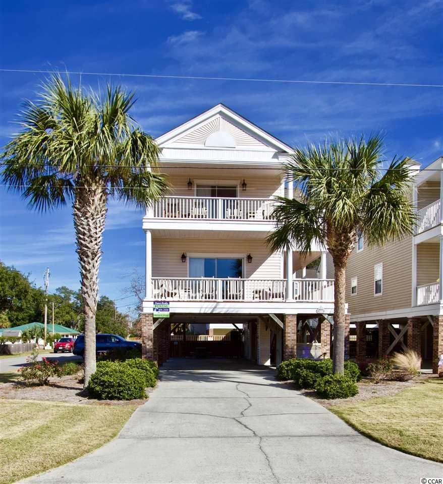 "A true luxury investment home.  Consistently among the highest rental income generators for 4 bedroom homes in Surfside Beach with a huge following of repeat guests.  Call LA for more information.  The pictures tell the story but you should see for yourself.  This is a charming and elegant 4BR 3.5BA raised home located on a large corner lot within 100 steps to the 8th Avenue South beach access point. The house is situated so that you can enjoy ocean views and cool breezes from either of the two covered front porches when you're not relaxing by the private gated, fenced and heated 12x24 pool. This not a cookie-cutter rental unit or cheap flip job - the owners renovated the home with higher end materials, appliances and updated and tasteful furnishings. Upgrades include a new roof, carpet with thick padding, crown molding, granite countertops, Hayward pool heater, HVAC system, modern lighting, original artwork and much more. Professionally landscaped as well. If you're looking for a ""new"" home feel in a wonderfully convenient location with all the amenities you'd expect to offer in a luxury beach rental, then look no further!"