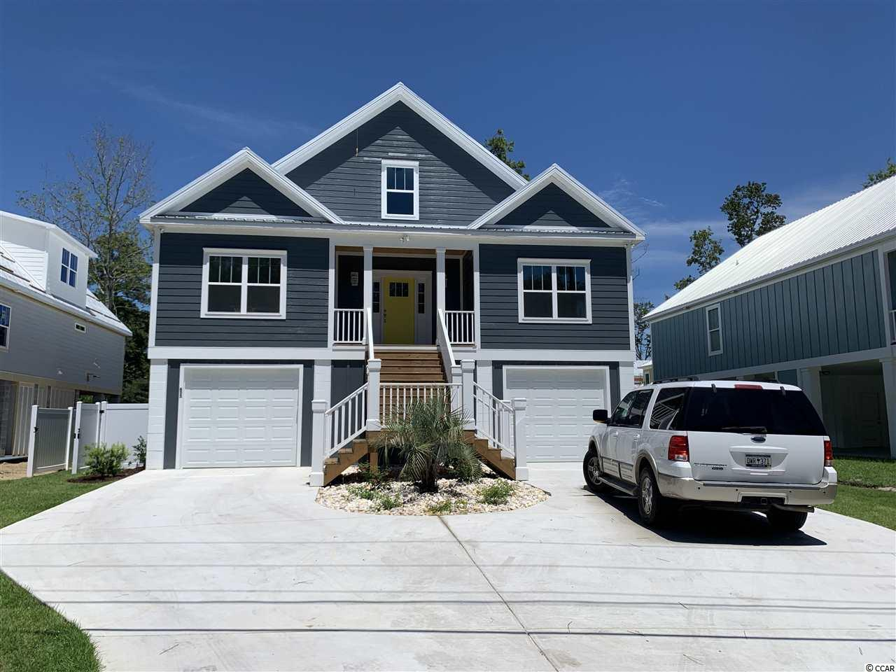 This home is a design-build. Looking for that perfect home but can't find it.  Give us a call and let our design team bring it to life.  There's only two more lots left on the S. Causeway.  Our builder will build it with a deposit and this keeps you from having to get a construction loan. NO HOA!