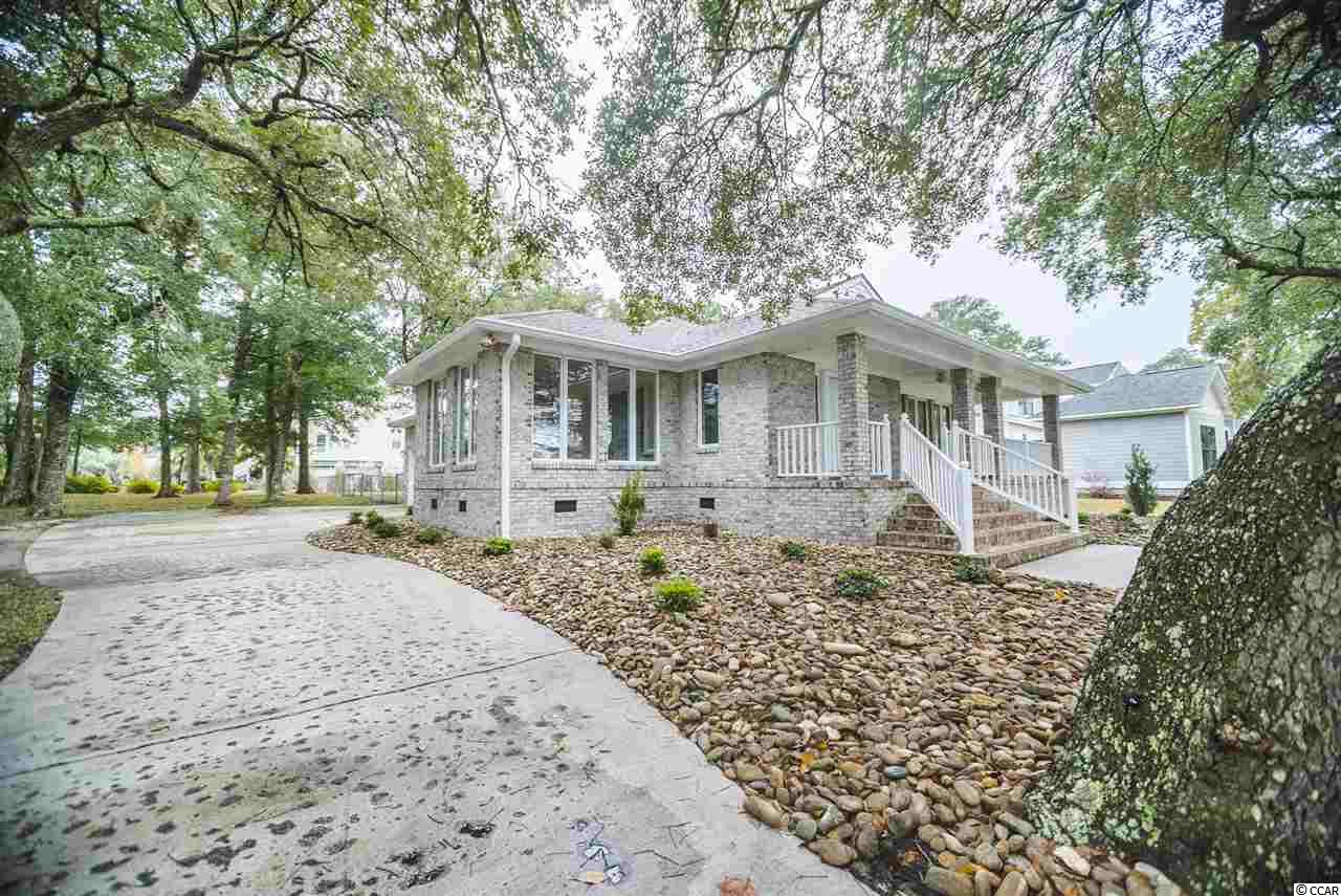 Arcadian Shores 3BR/2.5BA all brick home on large lot.  Fenced back yard, side load garage, etc. Ceilings have just been scraped, now smooth!  Buy now & pick your paint colors.  Lake views & just a short walk to the beach.