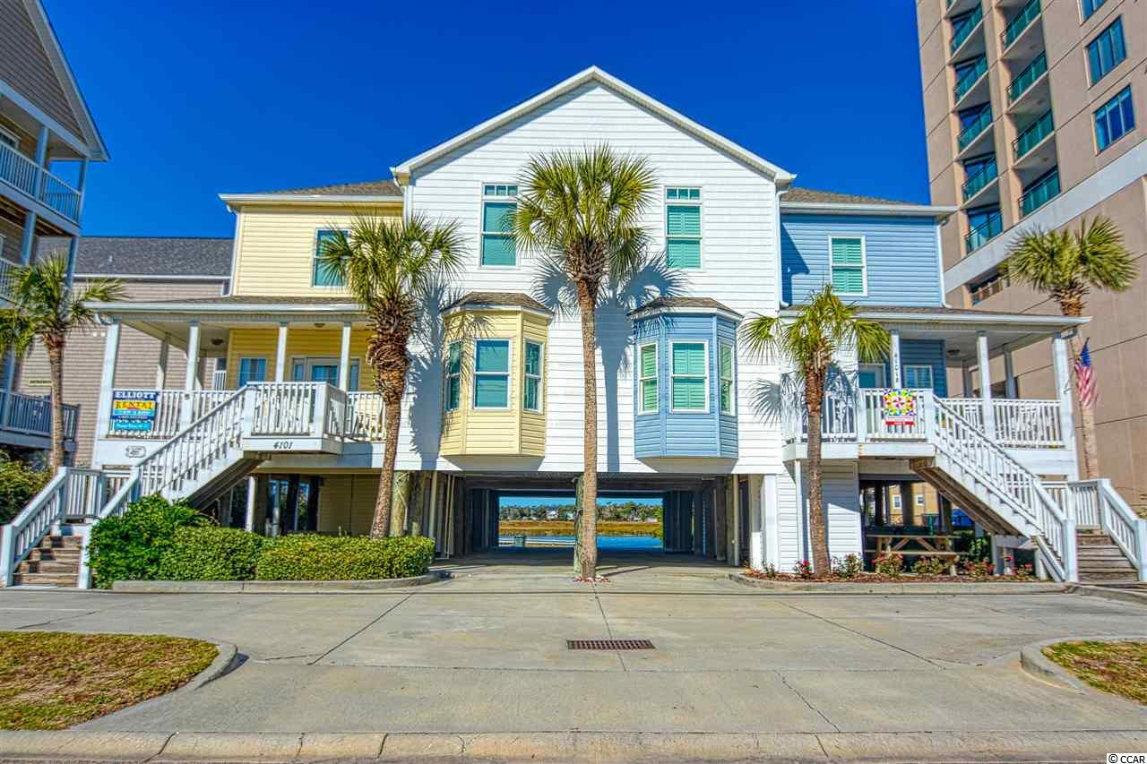 Rare opportunity to own a 4 bedroom 4.5 bath condo with ocean and inlet views. This gorgeous condo is directly across from the Atlantic and public walkway and behind it is House Inlet. This beautifully furnished condo has hardwood floors throughout. Sit on your wrap around porch and watch the ocean or walk to the inlet to crab and fish. You and your guests can spread out in the over 1800 square feet of living areas. Each of the 4 bedrooms has it on private bath. Close to to all the fun Cherry Grove and Ocean Drive have to offer. This condo has been meticulously maintained. New Siding in 2018, New Water Heater 2018, Hurricane Windows installed to resist winds of 120 mph. Central Vac. Great Rental income opportunity as well. No unit in this building has been for sale since 2003! Grab this while you can!