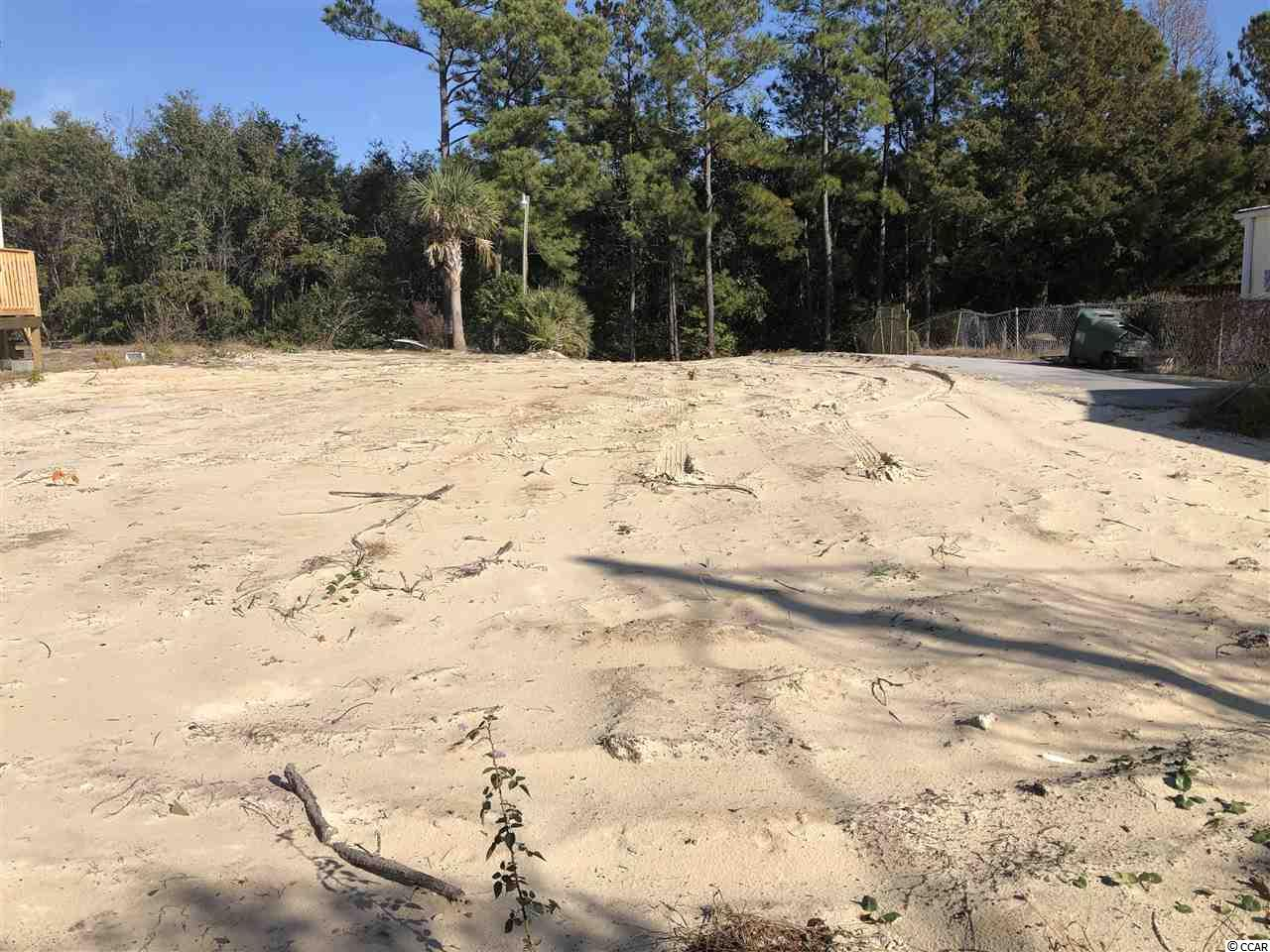 EAST of Business 17! Great lot only 1.5 miles to the ocean and 1/2 mile from the Intracoastal Waterway in Cherry Grove! You can build a custom home, or place a modular or mobile home on this lot. This is a unique opportunity that does not come along very often. The ocean, river and downtown are only a golf cart ride away!