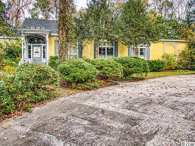 One of the best locations in Pawleys Island tucked away in Litchfield Plantation. This two bedroom, two and 1/2 bath is great for entertaining friends and family. Features include marble sinks, interior plantation shutters, butcher block island, butler's pantry,  a living room, a formal dining room, sunroom and interior atrium area as well as 10 foot ceilings throughout. The grounds are almost 1 acre in size and the rear of the home faces Willbrook Golf Course. The Litchfield Plantation community also has an onsite pool and pool house overlooking the rice fields. Owners also have access to a 3 story, ocean front beach house on the barrier island of Pawleys. The community is gated, offering security guards during daytime hours. Litchfield Plantation is close to several golf courses, beaches, gardens, dining, and shopping.