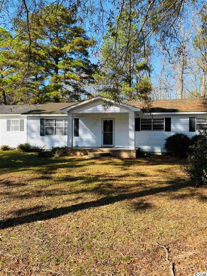 What a great opportunity to make this property your own! Having 3 bedrooms and 1 full and 2 half bathrooms, a large family room, living room, eat in kitchen and dining combination. Just outside the city limits on 2 acres, you have privacy, being tucked away off of Brick Chimney Road; wooded with mature pines and a detached workshop. Here you are just 5 miles from the Historic Downtown, restaurants, shopping and grocery stores!