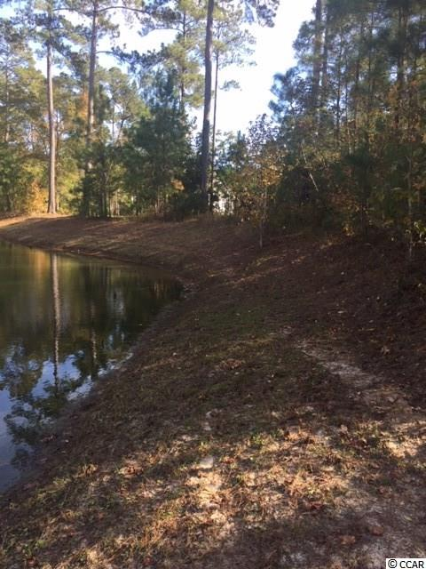 0.38 acre, wooded, pond in rear for privacy, 120' road frontage facing south, 140' deep.