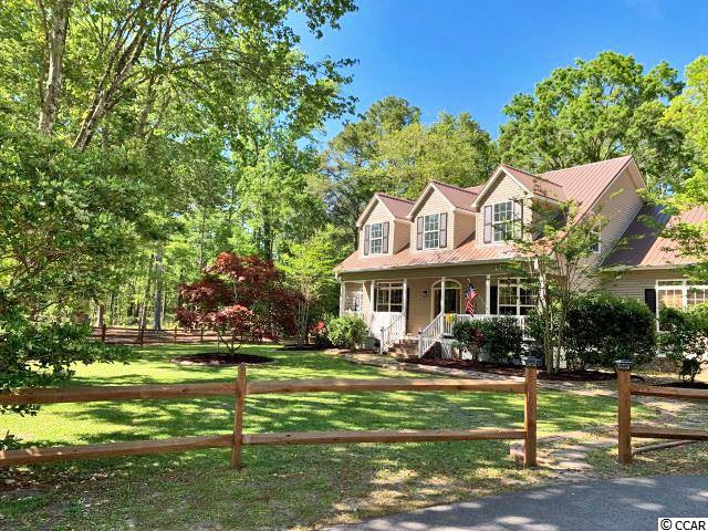 What a rare opportunity to find nearly two acres of land within the Murrells Inlet zip code! This NO HOA farm home is ideal for those looking for some land and privacy, but also still close enough to town for your everyday needs. This 4,300 heated square foot home has five bedrooms and a converted garage that was used for an in-home small business. This would make a great workshop or could easily be converted back to a garage space. The sellers just installed BRAND NEW, NEVER BEEN USED kitchen appliances, repainted the entire interior, and renovated the master bathroom, plus much more. Speaking of the master, the master bedroom and two other bedrooms are on the main floor. Upstairs, you will find two additional bedrooms, a bathroom and a large bonus space ideal for additional living space, man cave, theater room, home office, workout gym, etc. With over 1,000 sq. ft in this bonus space, your opportunities are certainly endless!!! The seller will also entertain installing carpet in this space for the new owner, or provide a credit for the buyer's choice of flooring if carpet is not preferred. But enough about the inside of the home. Outside, you will fall in love with the amount of land and attributes that this home has to offer. Sit on your large covered porch, or sit by the fire pit and enjoy the farm life just outside your front door. Currently used as a gentleman's farm, included is a two-horse barn, 60-foot round pen, two mini-horse barns, feed sheds, a chicken coop, and heated workshop.  A solar powered well and automated watering system are also installed and included for the farm area.  For the developers and investors, there is the also the possibility of subdividing this land into another residential lot. This is certainly a unique property to be located within the Murrells Inlet area and so many other features to come and see. Please call the listing agent, or your Realtor, for additional information or to schedule a showing!