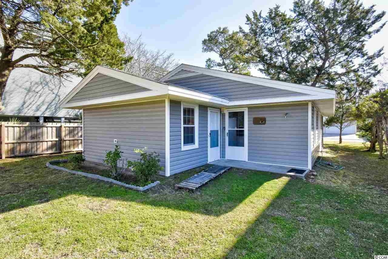 Welcome home to this 3 bedroom 2 bathroom home in the heart of North Myrtle Beach. This home has been completely renovated to include wood-laminate flooring throughout, new paint, crown molding, and more. The kitchen is equipped with all appliances and a dining area, while the living room is incredibly spacious with room for the whole family. Each bedroom includes plenty of closet space and easy access to a bathroom. Enjoy afternoons relaxing on your screened in porch with a ceiling fan, or on the beach just 2 blocks away. With no HOA and the perfect location, this is the home you have been looking for. Conveniently situated close to all of the Grand Strand's finest dining, shopping, golf, and entertainment attractions. Whether you are looking for your forever home, a second home near the beach, or your next investment opportunity, you won't want to miss this. Schedule your showing today!