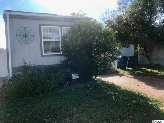 Large composite deck ! BRICK DRIVEWAY !  Cute 2bed/2bath home, Laminate floors through-out!  Trex decking and newer HVAC  Home conveys fully furnished !    Bank Financing is available...........................