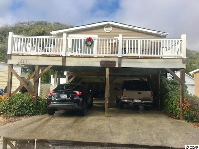 Great 2 bedroom, 2 bath pier home located only 1 street back from the beach! This home has a large open floorplan.  The kitchen features extra counterspace/breakfast bar.  The dining area opens to large front deck. This home has an outdoor shower, storage shed and golf cart garage below house. Excellent rental potential!  Bank Financing Available.