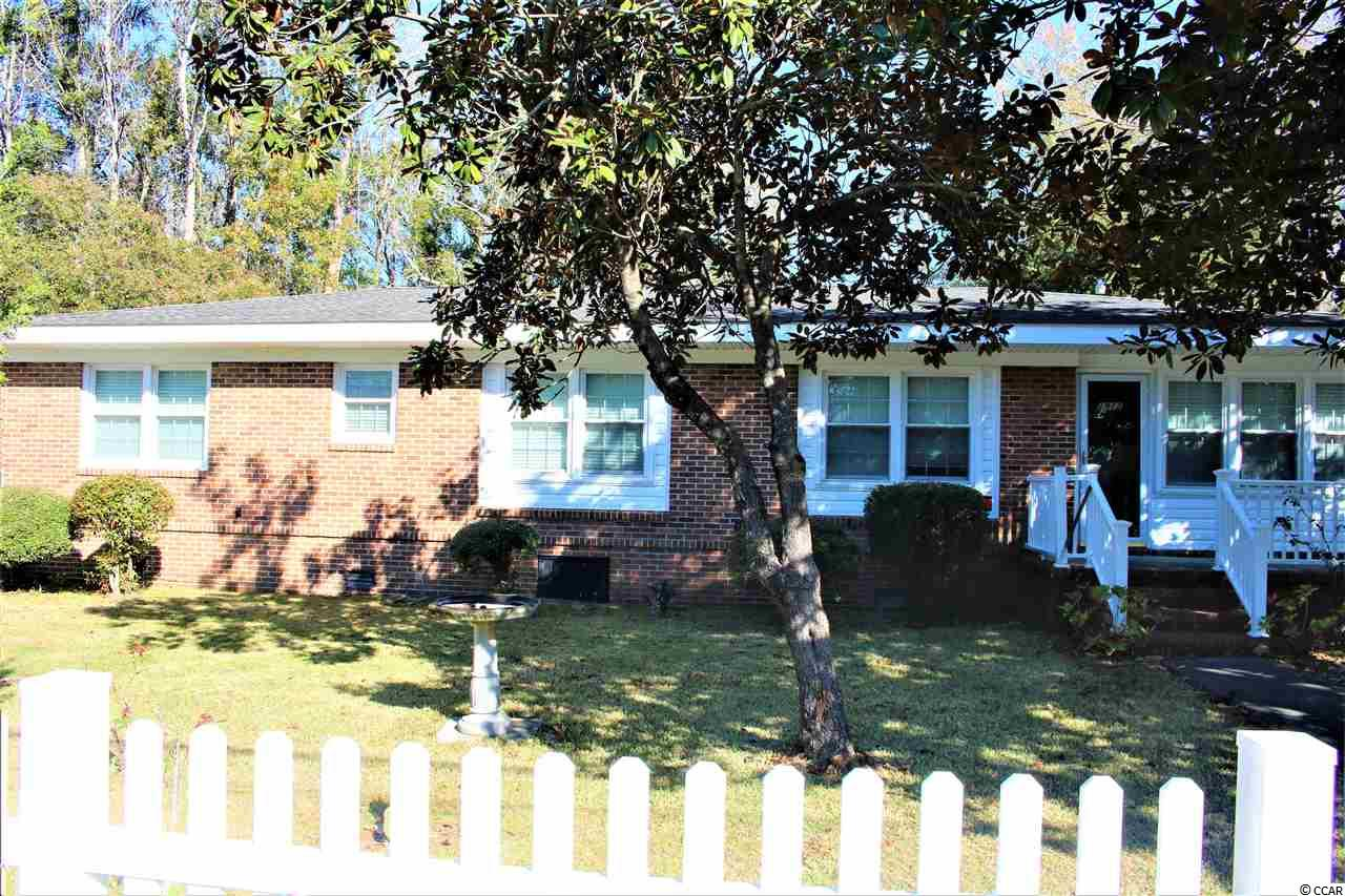 Large 2 bed 2 and a half bath brick home. There is a room that could be converted into a third bedroom. This home has a master bedroom with a walk-in closet and a full bath. the second bedroom also has a full bath. The house sits on a large lot with a fenced-in yard. The living room has hardwood floors and there is a screened-in back porch. A lot of house for that price.