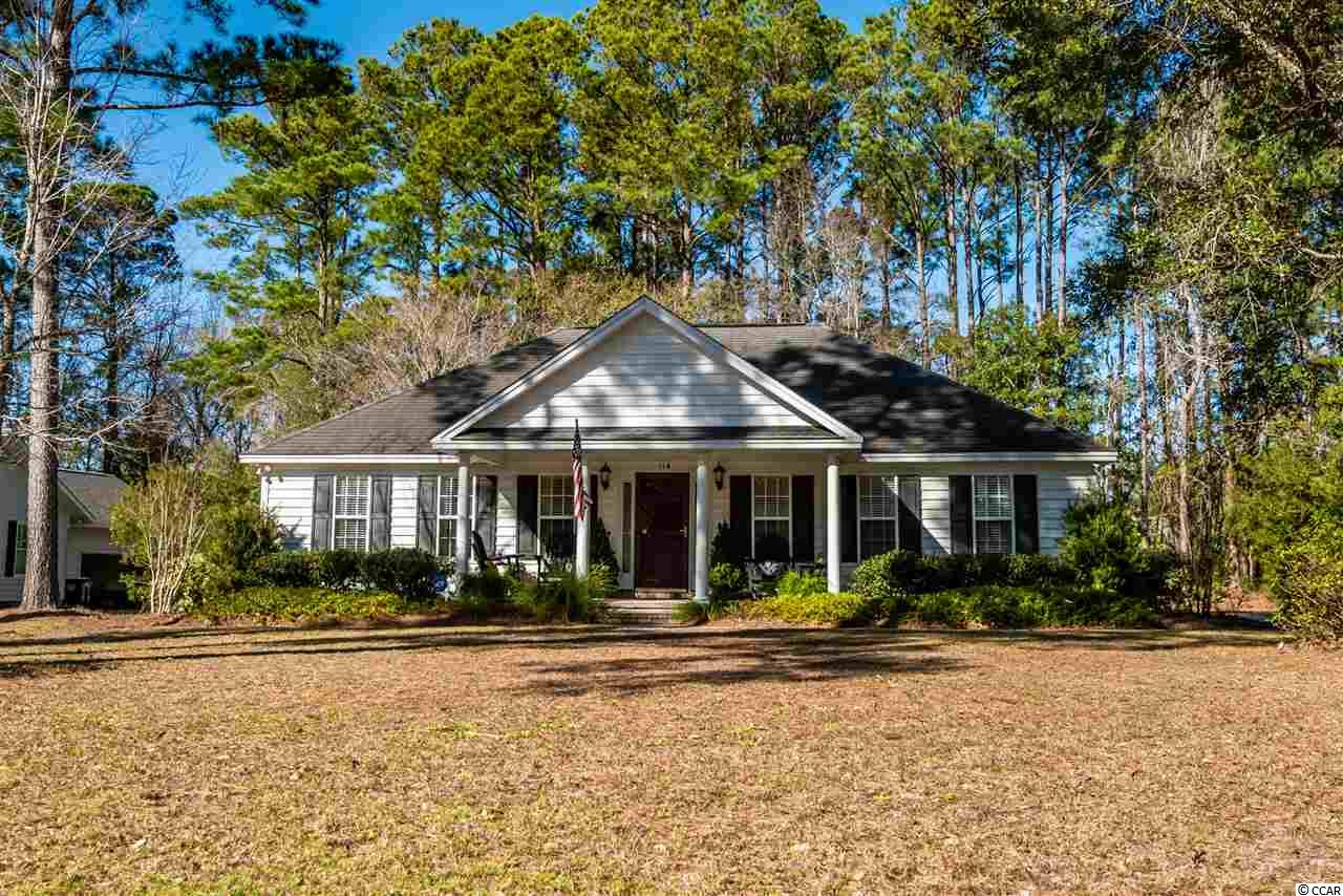 """Beautifully appointed, 114 Shipmaster is an """"all on one level,"""" split bedroom, open floor plan with a spacious Carolina Room and a huge, wooded back yard in Pawleys Retreat! As you walk inside from the large front porch, you're greeted with gorgeous hard-wood floors and a vaulted ceiling. The open, updated kitchen offers abundant cabinets, beautiful granite countertops, and a breakfast bar. The Carolina Room with vaulted ceiling opens to the patio and back yard featuring a wooded buffer for privacy. The relaxing master suite features a triple tray ceiling and walk in closet. Other features include: Brazillian Cherry Floors and Tile in the laundry room and bathrooms, professional landscaping, a gorgeous live oak tree, and an attached, outside storage room. Pawleys Retreat has a wonderful recreation area in the community, a boat storage facility, and is convenient to Waccamaw Schools, shopping, dining, churches, medical facilities and is right down the street from the public beach accesses on Pawleys Island."""
