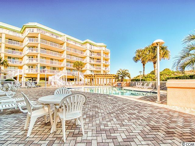 For those ready for what's next ... DIRECT Oceanfront and DIRECT access to the pool via convenient private steps from your unit.  What more could you ask for in a place at the beach? How about a stylish unit that is updated and fully equipped and furnished? This 3 BR, 3 BA unit at Warwick in Somerset at Litchfield by the Sea is centered on the wide, uncrowded beach of this private resort community. The floorplan is open and easy and flows from the kitchen to the dining area with wet bar, to the comfortable living space and out to the poolside balcony.  The unit features decorator decor with smart aspects for beach life ... tiled and laminate floors and open spaces! The kitchen has been updated with a granite counter tops and a stainless steel appliance package. The master bedroom has a fabulous view across the pool to the healthy dunes and the ocean. It also has a large walk-in closet and up to the minute master bath with pedestal sinks, a tiled bath, tub and water closet.  Litchfield by the Sea is a sought-after gated resort community with walking paths, tennis courts, stocked ponds throughout and an oceanfront clubhouse for owners' use.  Pack your bags and head to the beach .... 102 Warwick is calling your name!