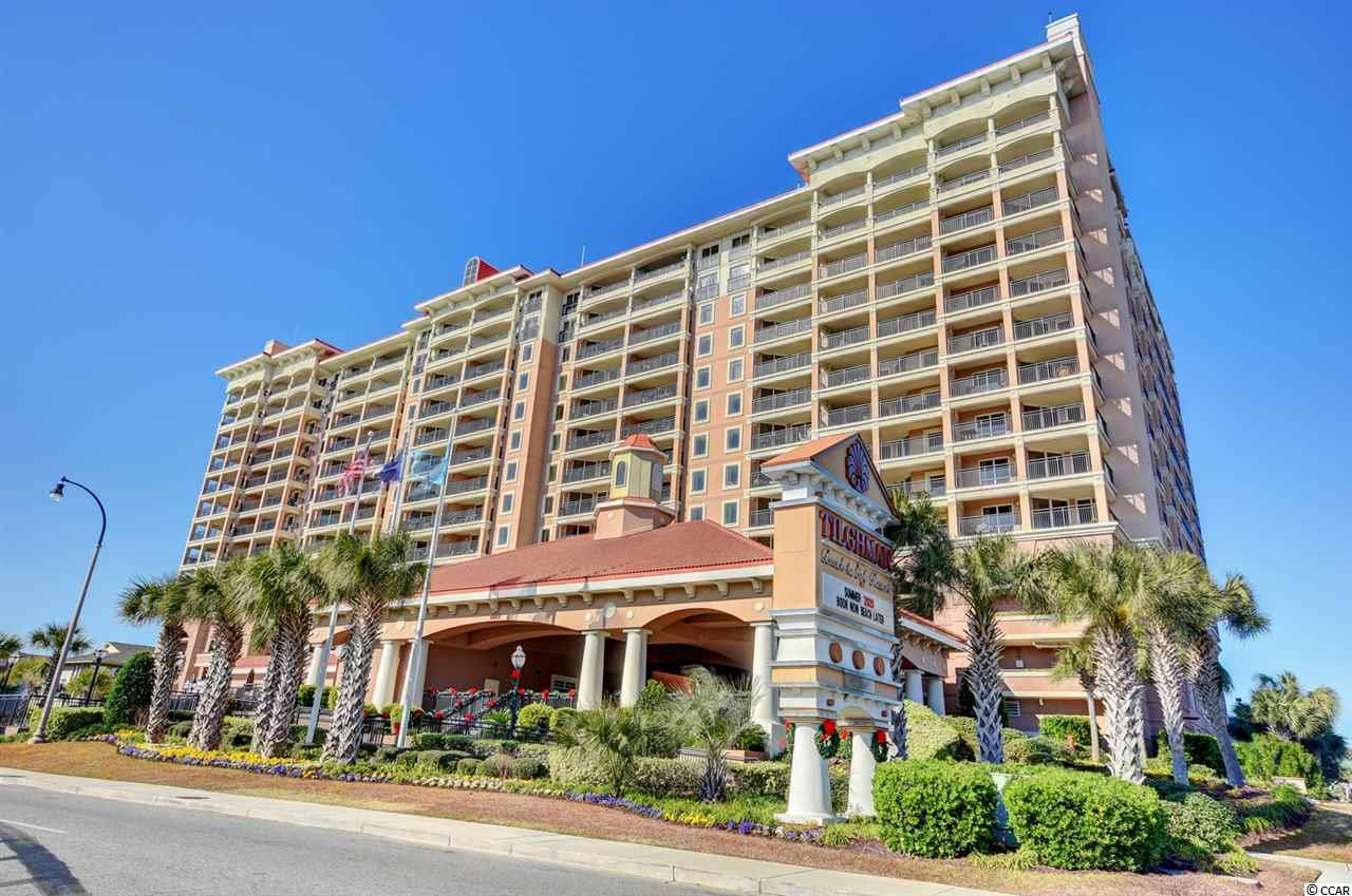 Executive two bed, two bath condo available in the prestigious Tilghman Beach & Golf Resort. It is very nicely updated with granite counter tops in the kitchen and bathrooms, offers a full kitchen with all appliances, fully equipped with upscale furnishings, room for six at the dining room table and three at the breakfast bar, and comes with a washer/dryer conveniently in the unit. Enjoy the ocean breeze on the extra long balcony overlooking the ocean on one side and a lake on the other. Tilghman Beach & Golf Resort offers luxurious amenities including an indoor pool, an outdoor pool, a lazy river, and an exercise room. The resort is located in Cherry Grove across the street from the ocean with plenty of restaurants within walking distance, and other entertainment and shopping just a few miles down the road at Barefoot Landing and Tanger Outlets in North Myrtle Beach. Schedule a showing today!