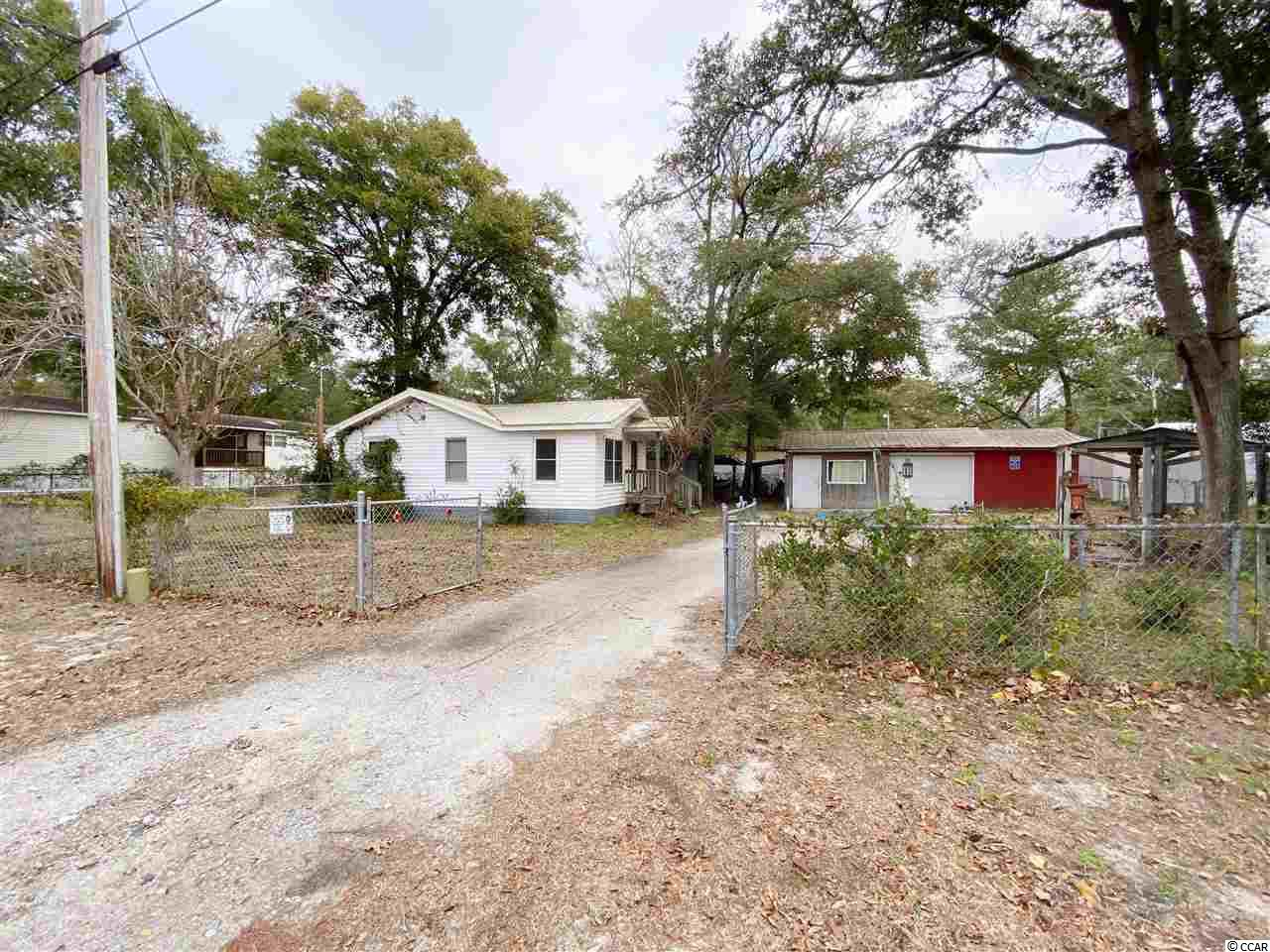 HANDYMAN SPECIAL!!! The lot is where the value is. One of the largest lots in The Grove, double size lot! This is a 1956 single wide manufactured home that has been added on throughout the years. There is a small apartment built in the shed with a tenant in place. Great rental potential! Buyer is responsible for all measurement verification!