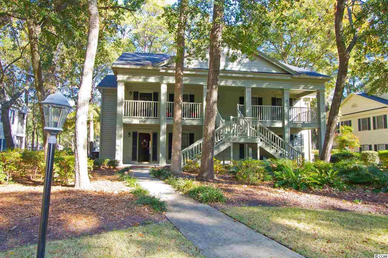 Weekhawka Woods provides a beautiful quaint setting within Pawleys Plantation - a private gated golf community a few miles from Pawleys Island Beach.  Weekhawka Woods has an outdoor pool for its residents and guests.  This sought after well maintained 1st flr unit on the 11th fairway features furniture and fixture upgrades, crown molding with fabric valances, newer water heater, dishwasher and HVAC system, wet bar in living room and a great winterized rear screen porch for year round use accessible from the living room and also the master bedroom.  130-1 Stillwood Dr provides the perfect getaway - only minutes to golf, beach, dining and shopping and just a little over an hour from Charleston.  Full and Social memberships are available for purchase.  A great vacation rental or full time residence awaits.  Move-in-ready.  Square footage is approximate and not guaranteed.  Buyer is responsible for verification.