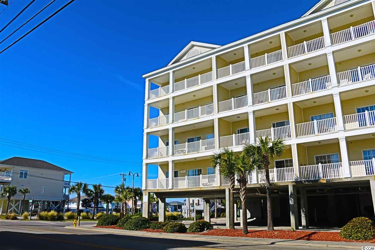 **OPEN HOUSE SUNDAY 1/19 FROM 1PM to 4PM--PRICE REDUCED $20,9000** Unique from the front door to the ocean view balcony, this second floor condominium is exquisite.  This small oceanview resort is located in the Cherry Grove section of North Myrtle Beach and only blocks from the famous fishing pier.  While this second row building is unassuming on the outside it is fabulous inside.   Offering a spacious floorplan with 4 bedrooms and 3 baths, a large kitchen/dining/living room that will accommodate the entire group, and an oversized balcony to enjoy the sounds of the ocean.  With tile flooring throughout, 2 refrigerators, a ginormous family dining table, on property pool and hot tub, and a walk across the street to the sandy beaches of Cherry Grove this is VACATION at its best.