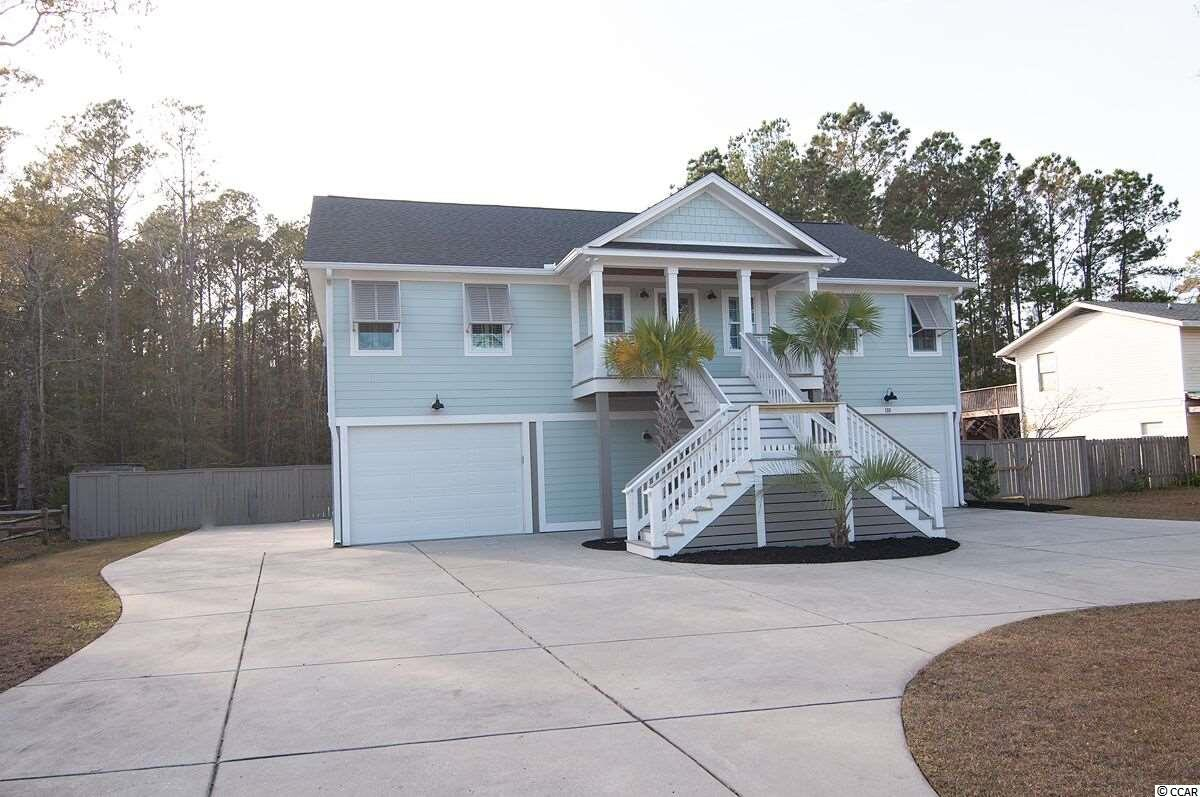 Sellers have to relocate and they hate to leave. This home was custom built and offers an open floorplan with split bedrooms upstairs on main living area. The kitchen has granite counters, stainless appliances, pantry and a large farm style sink. The master bedroom features tray ceiling, large walk-in closet and an attractive en-suite bath. Downstairs has a flex room and full bath and another large storage room/workshop. You can park your boat, jet skis, trucks, cars, golf carts, etc. under this raised beach home, and plenty of pad outside for RV. The exterior of the home is hardiplank siding with Bahama shutters, porches, decks, and a large fenced backyard. Hagley community has a public boat landing on the Intracostal Waterway and no HOA, and is less than 2 miles to the beach. Square footage is approximate and not guaranteed. Buyer is responsible for verification.