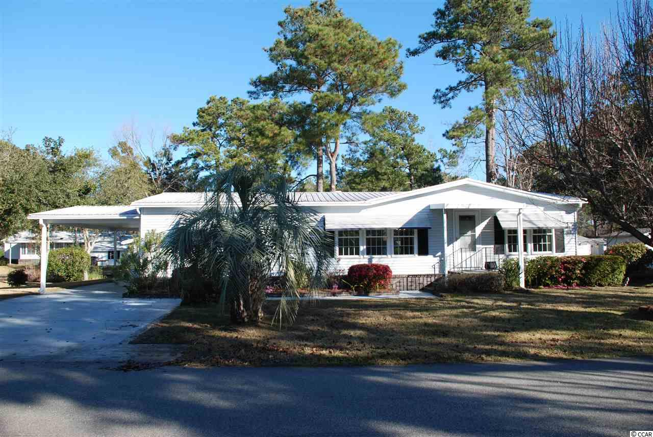 Leisure living in retirement. 55+ Beach / Lake Community a mile from the beach in Murrells Inlet, offers 2 pools, 2 clubhouses, exercise equipment , bocce ball court. This large 2 Bed / 2 Bath Home has new carpet in the heated and air-conditioned Carolina room. New washer, dryer, and refrigerator. Hardwoods in Living, Dining and Bedrooms. Solid surface counter tops in Kitchen. New paint throughout. Large garden tub in master bath. Detached 12 x 17 workshop / storage building with second refrigerator.  New AC/ Heat Pump in 2015 and new metal roof in 2011 Call Today to Schedule a Showing! Must Come Visit!