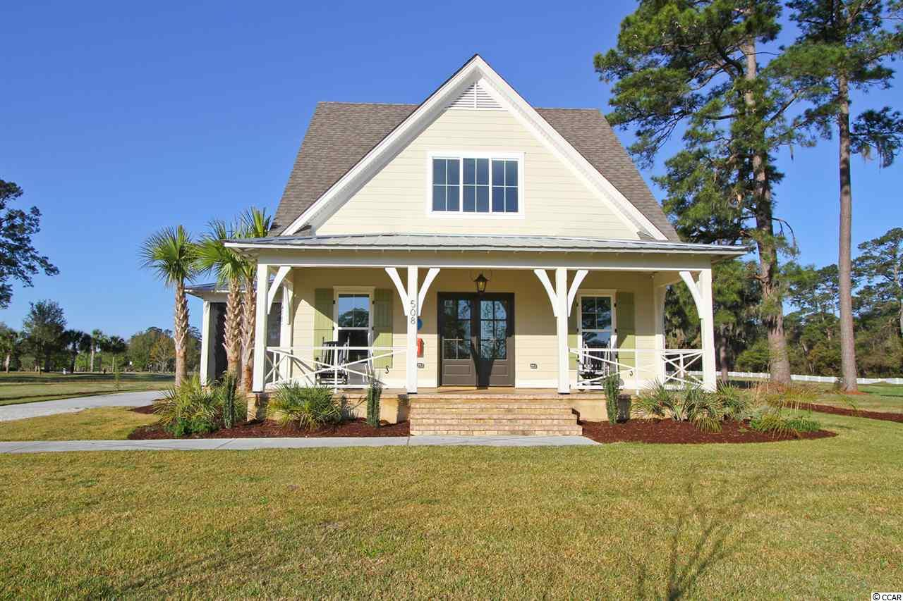 Just completed, the first of 22 Dowling Custom Homes planned in the spectacular waterfront gated community of South Island Plantation. The Cypress Pond model boasts picturesque windows, open rafter tails, shaped columns and operational cypress shutters overlooking  a natural low country pond and landscape with paths leading to the dock of the ICW. Inside you'll find 2200 Sq. Ft. with the center of this special home warm and welcoming to the open concept floor plan that's sure to become the go-to spot for your neighbors and friends.  This home includes three bedrooms each with their own bathroom and an additional half bath, plus a recreational room. You'll find the laundry room/Drop Zone (mudroom) well located on the first level. To ensure the time spent at home is truly enjoyed, Dowling added two broad porches with acid washed finishes with one screened in. Dowling Homes ensures all clients peace of mind with Liberty Mutual's 10 year extensive warranty. Home is well secured with a complete Nest camera and door locking system. Voted 2018 USA Best Coastal Town, the gated community of South Island Plantation is located on the intracoastal waterway in the small community of Georgetown on the Carolina coast between Charleston and Myrtle Beach. Amenities include members only Winyah Bay clubhouse and pool, 3 miles of walk/run/bike paths and a well designed exercise station system along the path. The ICW dock system will include drive on docks and the rare opportunity to dock your boat 24/7 only a short golf cart ride away from your home. Other amenities will include both kayak launch system and storage. For South Island Plantation Dowling Homes has designed it's Winyah Bay Coastal Collection to fit harmoniously into this wonderful seacoast setting.