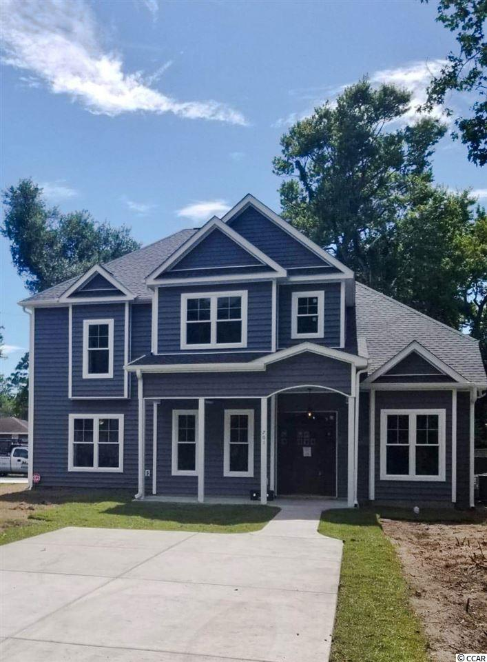 RARE FIND- Like New, Custom Built 5BR/3.5BA Home Located in the Heart of Myrtle Beach with NO HOA! Only 5 Blocks from the Ocean- This Gorgeous Home is Only a Year old and Loaded with a Multitude of Unique Upgrades that Must see for yourself! Living Room Boasts 15 ft ceilings, 7 Windows & 8ft Four Panel Glass doors Which Allow Lots of Natural Light to Shine. Open Concept is Perfect for Entertaining Guests or Relaxing in Front of the Modern Fireplace. Spacious Study Makes for a Perfect Office, Man Cave or Theater Room. Kitchen Features Leather Granite Counter Top, Granite Island with Breakfast Bar, Breakfast Nook, Glass Induction Cook Top, Double Convection Oven, and 42 inch Custom Self Closing Cabinets. Gorgeous LVP Flooring Throughout Main Living Areas. Elegant Staircase Made of Real Wood. 2 Masters Suites- One on Each Floor. Each floor has its own Laundry Room for Added Convenience. 2nd Floor Master Suite Features a Balcony Perfect for Sun Bathing. Luxurious Master Bathroom Includes a Glass Tile Shower, 12ft Extended Vanity, and Modern Soaking Tub with Free Standing Floor Mount Faucet. Other Amazing Features include Granite Counter Tops in all Bathrooms & Laundry Rooms, Butlers Pantry in Formal Dining Room, Floor to Ceiling Tile in All Showers, Outdoor Shower with Hot & Cold Water, 3 Climate Zones, 8 ft Doors Throughout Home, Extended Garage to Fit Full Size Truck, and So Much More!  Be sure to Check out the Virtual Tour! Schedule Your Showing Today- You Don't Want to Miss Out on this One of a Kind Dream Come True.   Measurements are estimated and Exact Dimensions should be verified by Buyer.