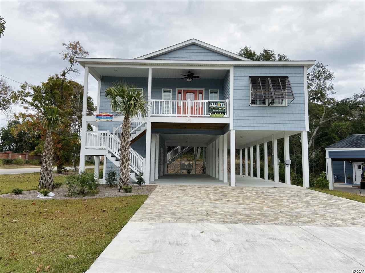 """FULLY FURNISHED 4 bedroom 3 bath raised beach house- with NO HOA!!! This young home was built just in 2018, and has SUCH a tasteful/rich feel. You will find recessed lighting, a great amount of storage space, quartz countertops throughout, and like new stainless steel appliances, just to name a few of this homes many features.   Sitting along """"Hillside Drive"""", this home shines! ...Less than A MILE away from Main Street, Ocean Drive, and most importantly- THE BEACH!!  This home is turnkey ready and would make a wonderful primary home, OR vacation rental property. Put this one on your list!"""