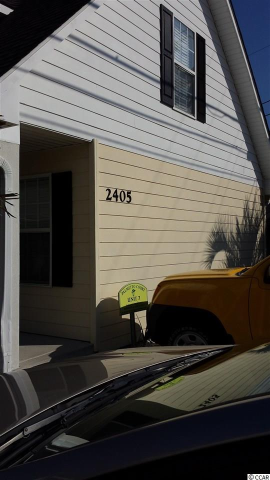 Adorable townhouse-style condo less than a quarter of a mile away from the ocean! The pictures simply don't give this rare find the credit it deserves, so don't miss out by overlooking this one! The first floor of this condo features a spacious living area that leads into a full kitchen. Upstairs, you'll find a large master suite with two closets and a full bathroom. Enjoy all the benefits of living at the beach without the ridiculous cost! Palmetto Court is a private, close-knit community located in the Cherry Grove section of North Myrtle Beach. There are plenty of restaurants, grocery stores, gas stations, and attractions within walking distance. Ride down Ocean Boulevard or take the easily accessible route of Highway 17 to Barefoot Landing, Restaurant Row, Tanger Outlets, and more just a few miles down the road. Put this one at the top of the list and schedule a showing today!