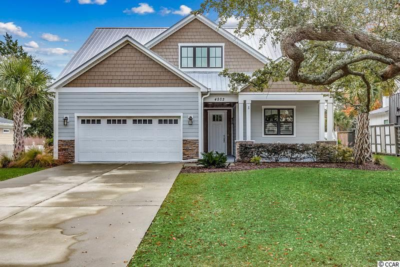 Rare find in this like new home in Old Pine Lakes.  This beautiful, contemporary home built in 2015 sits on a 1/4 acre lot with mature Oak Trees and a fully fenced back yard giving you the ultimate privacy and plenty of room to add a pool if you desire.  You will notice the minute you walk in the foyer the attention to detail and the unique architectural design of the vaulted ceilings and custom windows that give the home a french country feel with modern finishes.  The upgraded kitchen offers custom cabinets, granite counter tops, stainless appliances including a gas cook top (natural gas services the cook top and tankless hot water heater) Kitchen is open to dining area and family room.  The first floor master also has unique vaulted ceilings with walk in closet and double vanity.  The second floor has 3 additional bedrooms and 2 full baths. The best feature of this home is the location!  Centrally located in the heart of Myrtle Beach golf cart to the beach and to many of Myrtle Beach's best restaurants. Don't delay!  Call for more information or private viewing today.