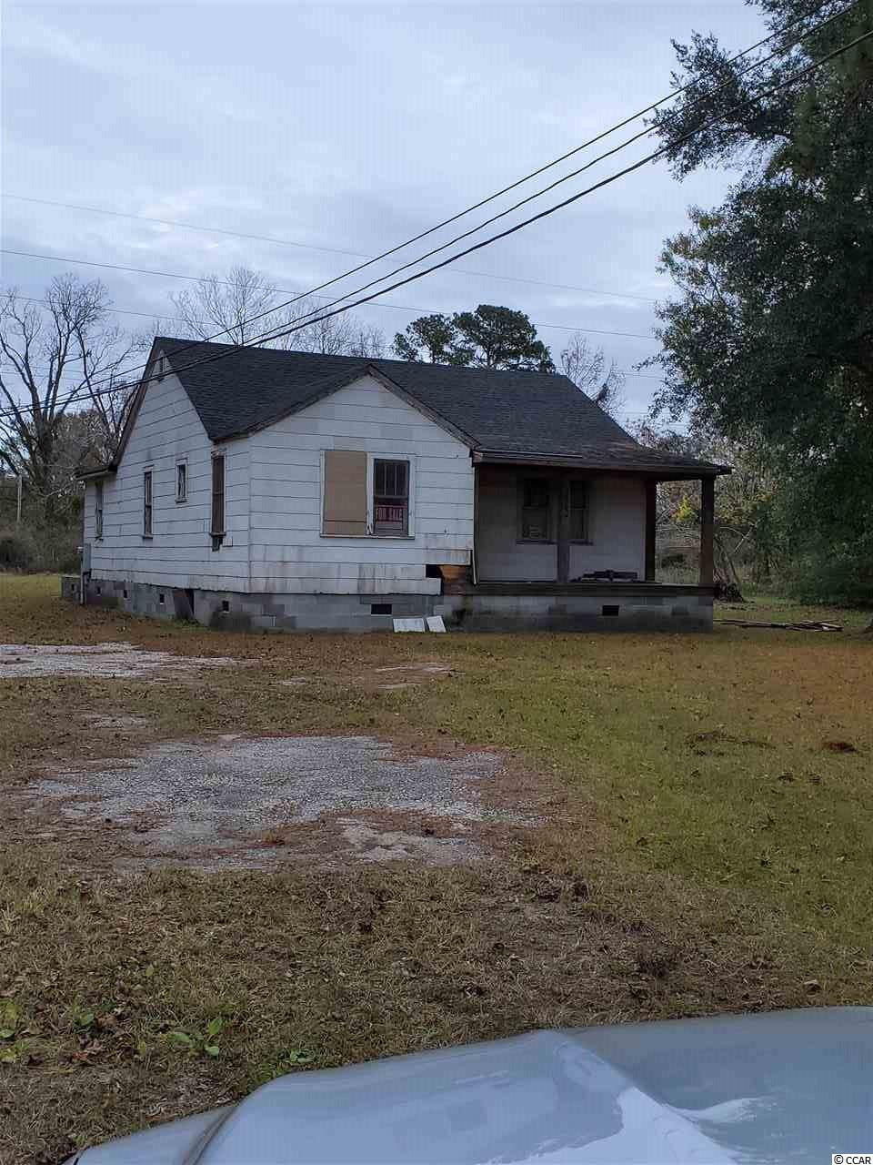 This is a fixer upper, a handy mans dream. Over an acre of land.   The house was an old beach house that was moved onto the property.  It has been taken down to the studs and ready for someone to make it their own. The roof is new and there are new windows inside of the house to be installed once house is completed. The mobile home is a bonus for the handy man or investor. Two properties on one land. The mobile home is in need of a new roof and the floors need to be redone please be careful walking around in the mobile home.